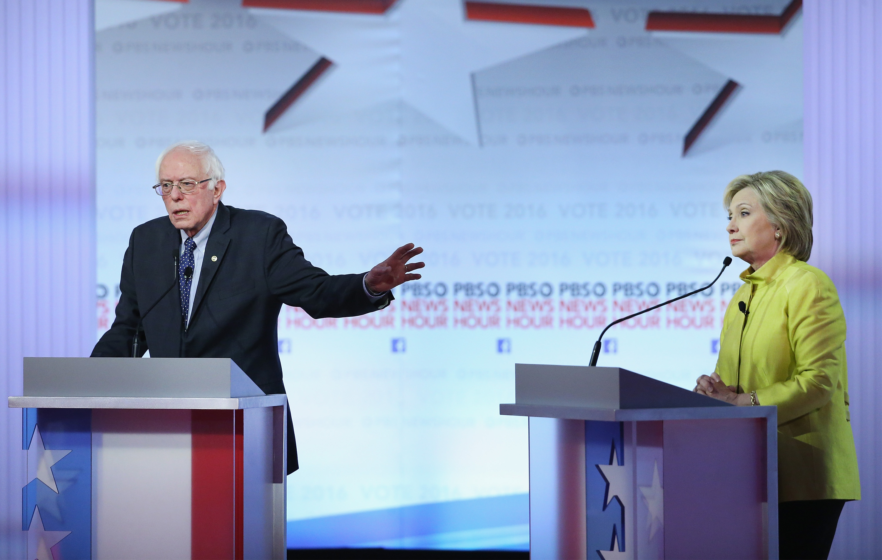 Bernie Sanders (L) and Hillary Clinton participate in the PBS NewsHour Democratic presidential candidate debate at the University of Wisconsin-Milwaukee on Feb. 11 in Milwaukee, Wisconsin.