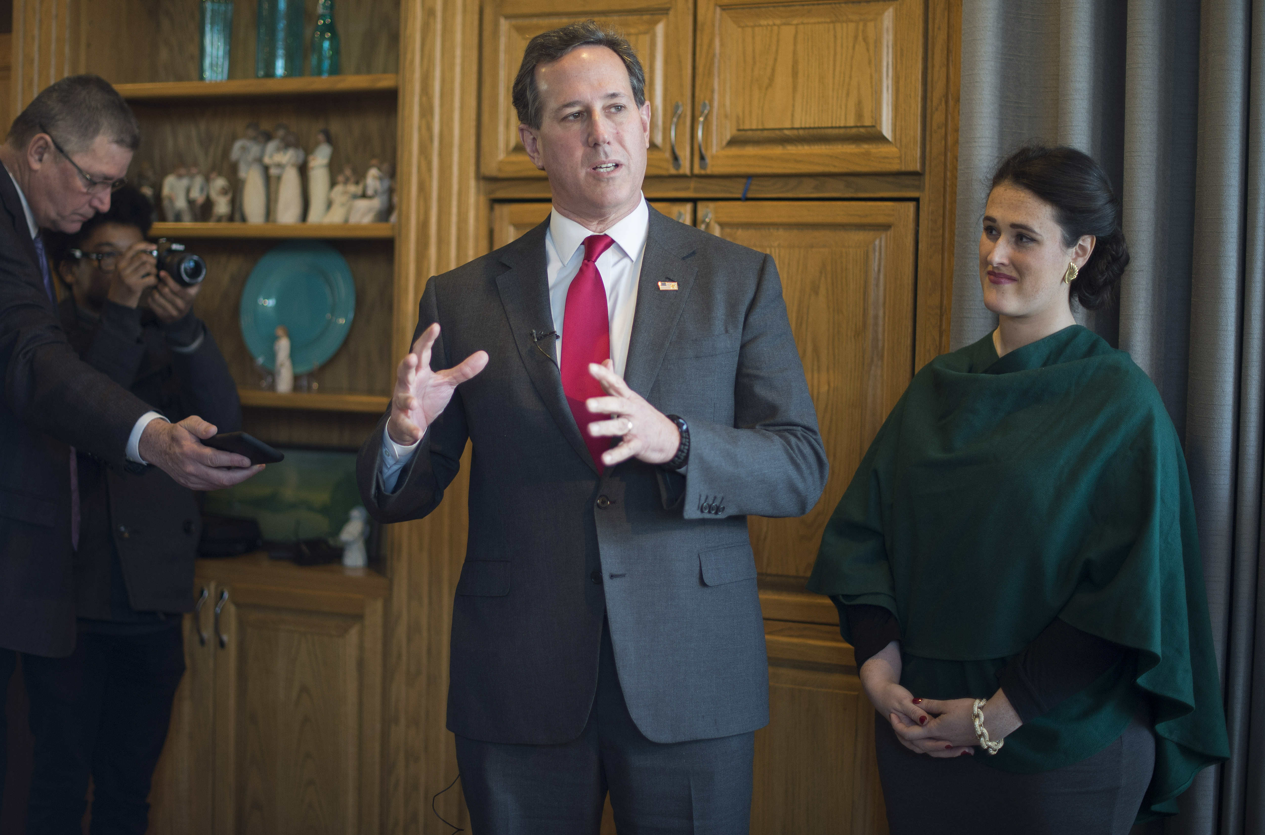 Republican presidential candidate Rick Santorum speaks beside daughter Elizabeth during a campaign stop at a private residence in West Des Moines, Iowa, on Jan. 31, 2016, ahead of the Iowa Caucus.