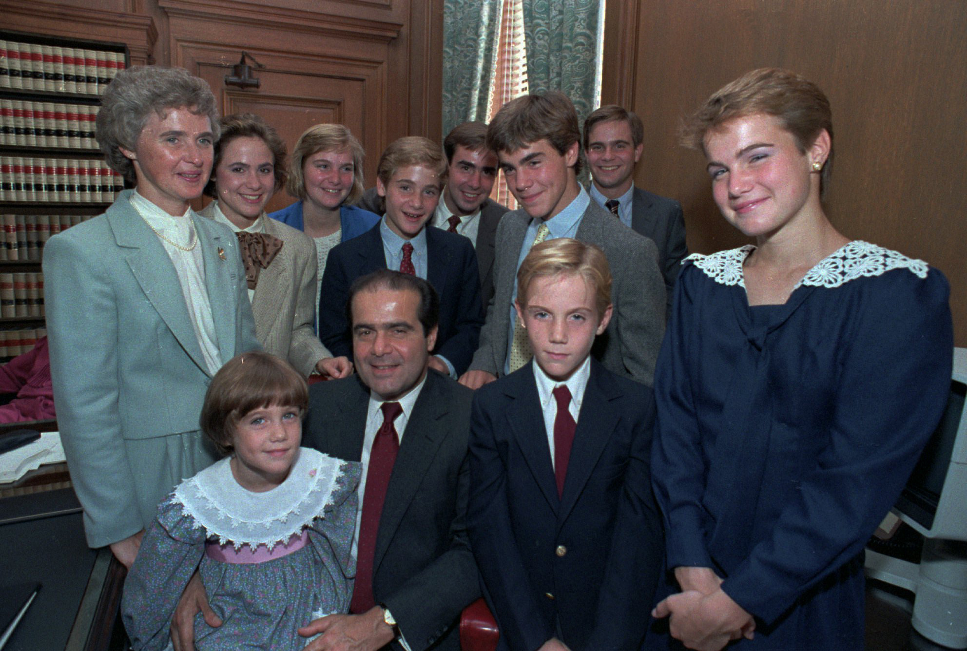 Antonin Scalia poses with his family in his chambers before court ceremonies on Sept. 26, 1986 in Washington, D.C.