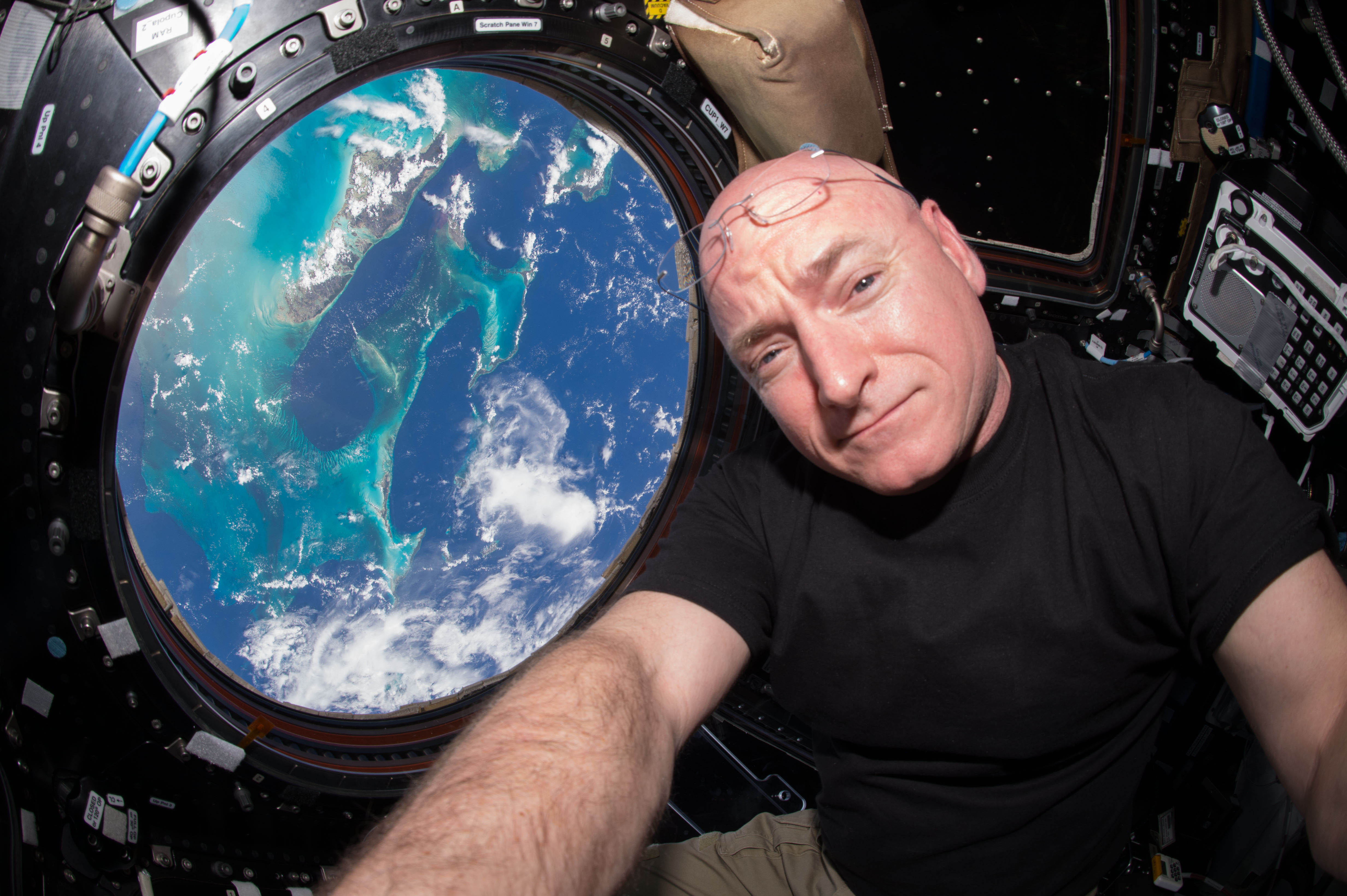 Scott Kelly poses for a selfie photo in the  Cupola  of the International Space Station.