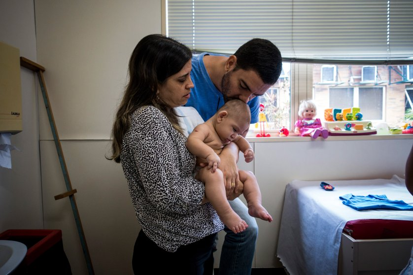 Isabel and Moises Albuquerque and their son son at the Associacao de Assistencia a Crianca Deficiente, a rehabilitation center for disabled children, in Recife, Brazil, Feb. 1, 2016.