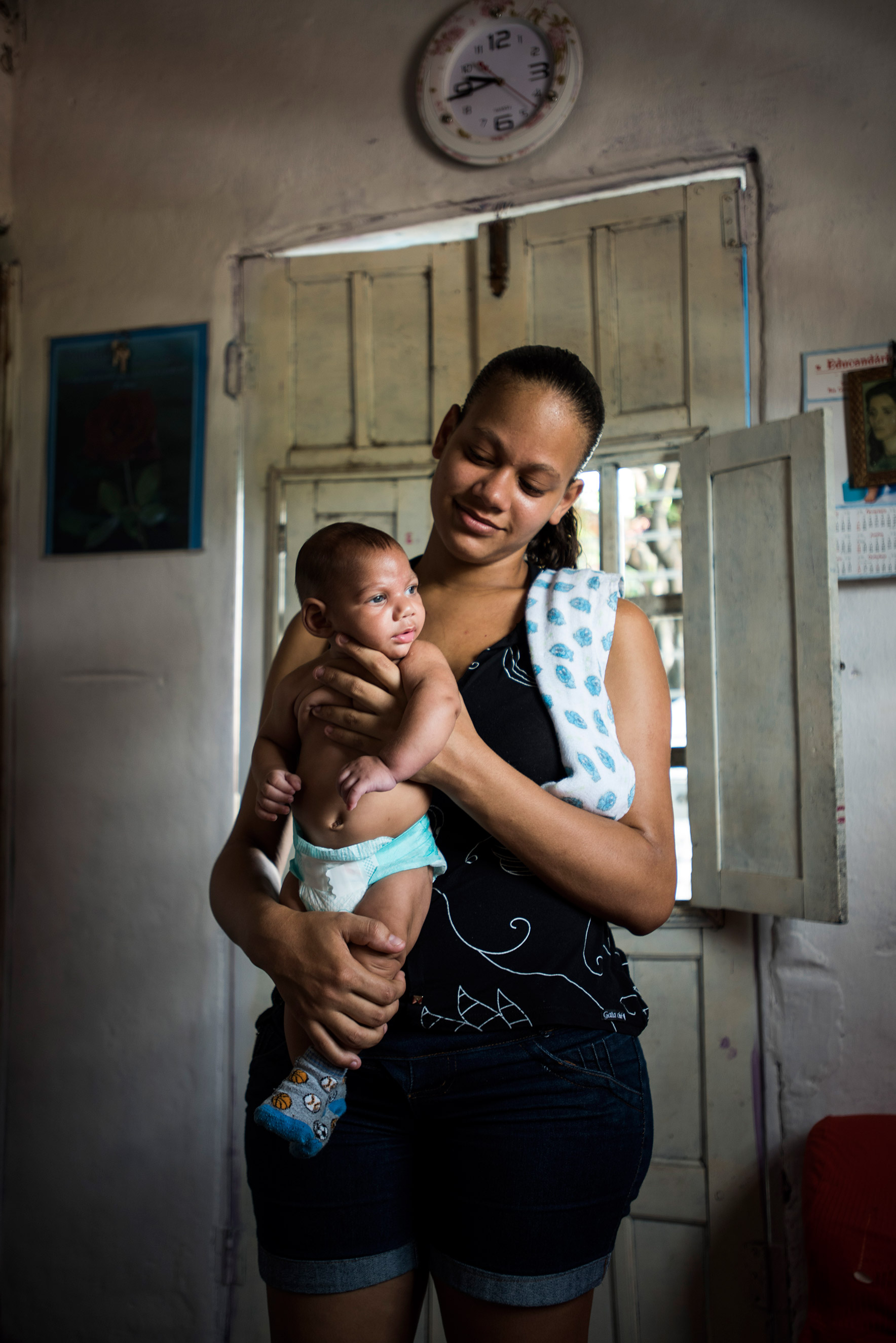 Juliana Diniz da Slva, 22, with her three-month-old son, Pedro Henrique da Silva, in her house in Nova Descoberta, a favela in the outskirts of Recife, Brazil, Feb. 2, 2016. When she was seven months pregnant, doctors discovered the baby had the rare birth defect.