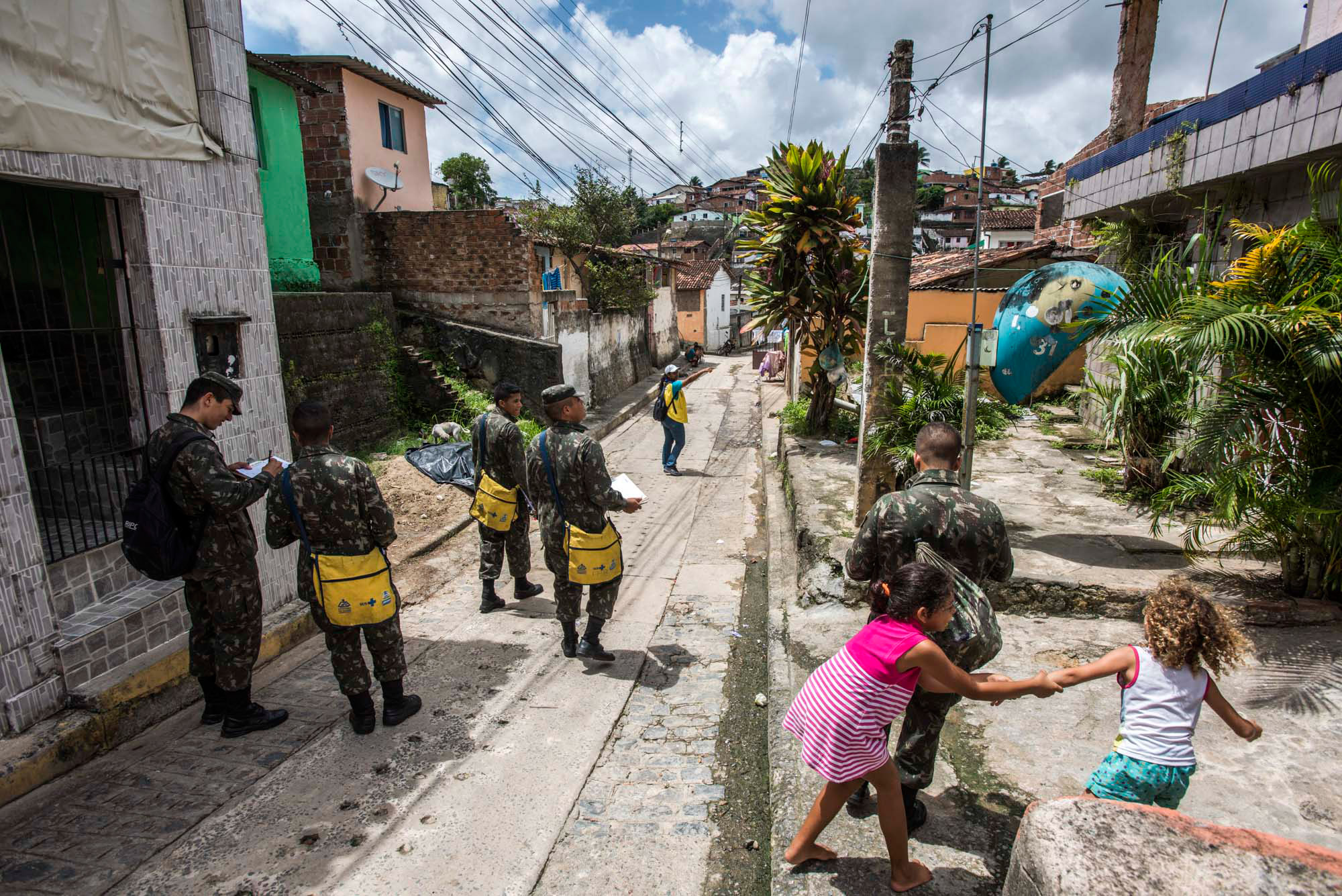 Members of the military walk the streets of the Nova Descoberta neighborhood in a campaign to prevent the transmission of the Zika virus in Recife, Brazil, Feb. 2, 2016.