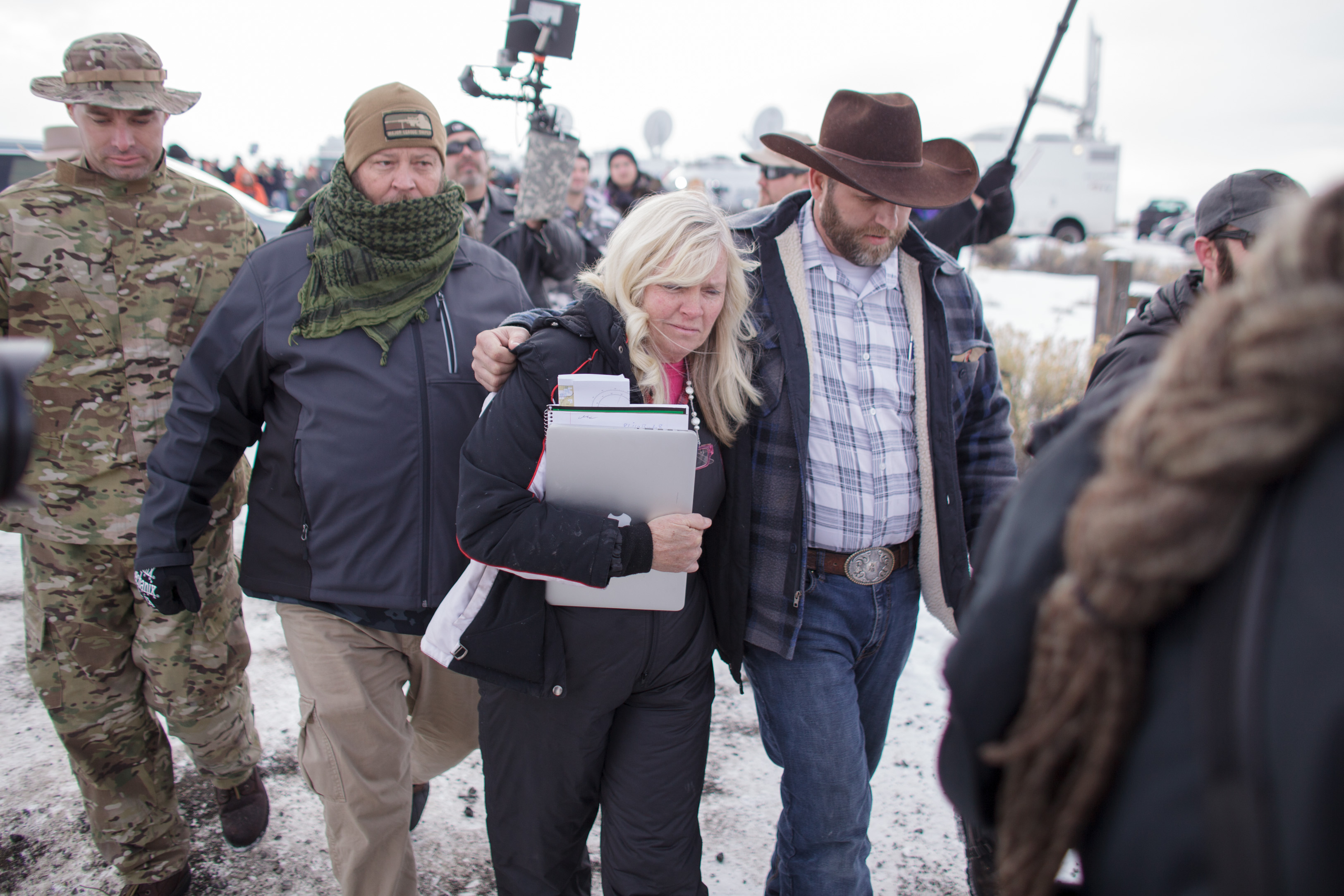 Ammon Bundy and Shawna Cox after speaking to the media as other members look on at the Malheur National Wildlife Refuge near Burns, Oregon on Jan. 4, 2016.