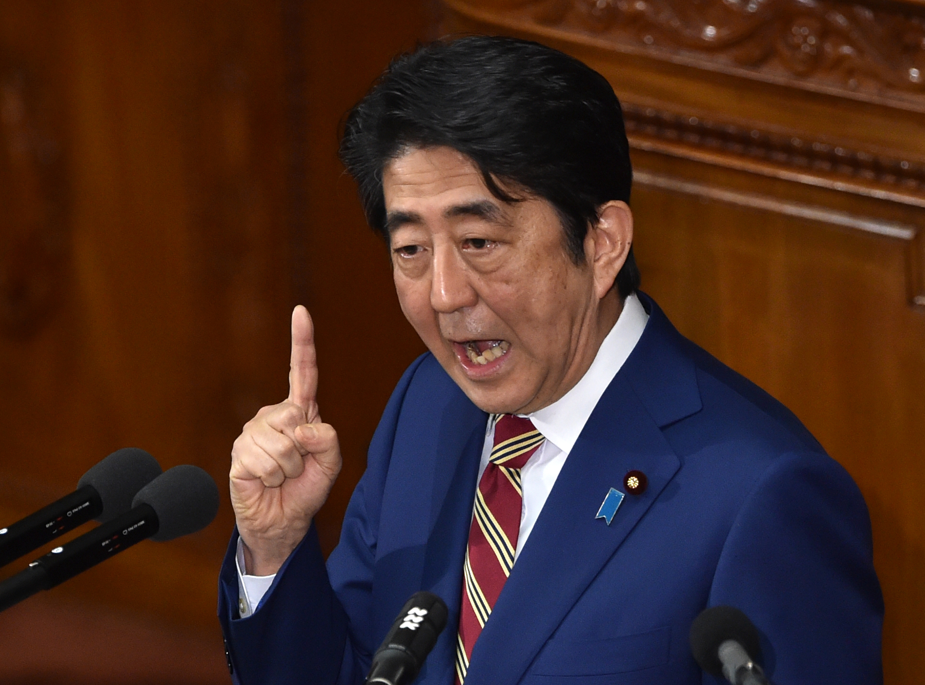 Japanese Prime Minister Shinzo Abe delivers his policy speech during a plenary session of the House of Representatives in Tokyo on Jan. 22, 2016.