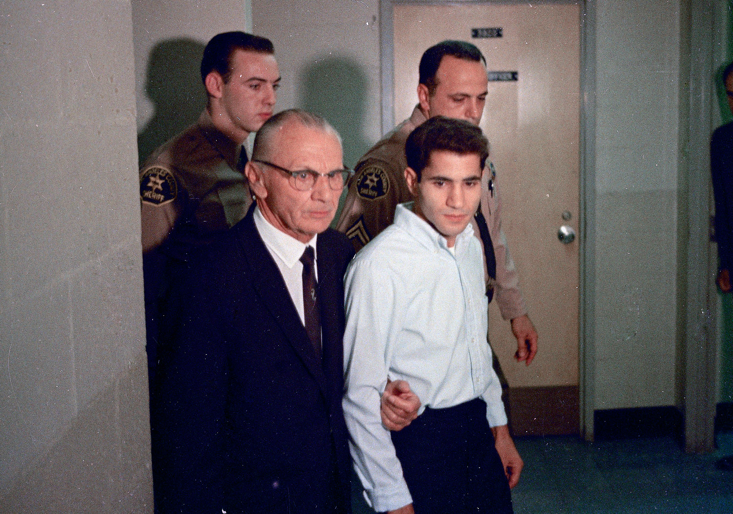 In this June 1968 file photo, Sirhan Sirhan, right, the assassin of Sen. Robert F. Kennedy, is seen with his attorney Russell E. Parsons in Los Angeles.