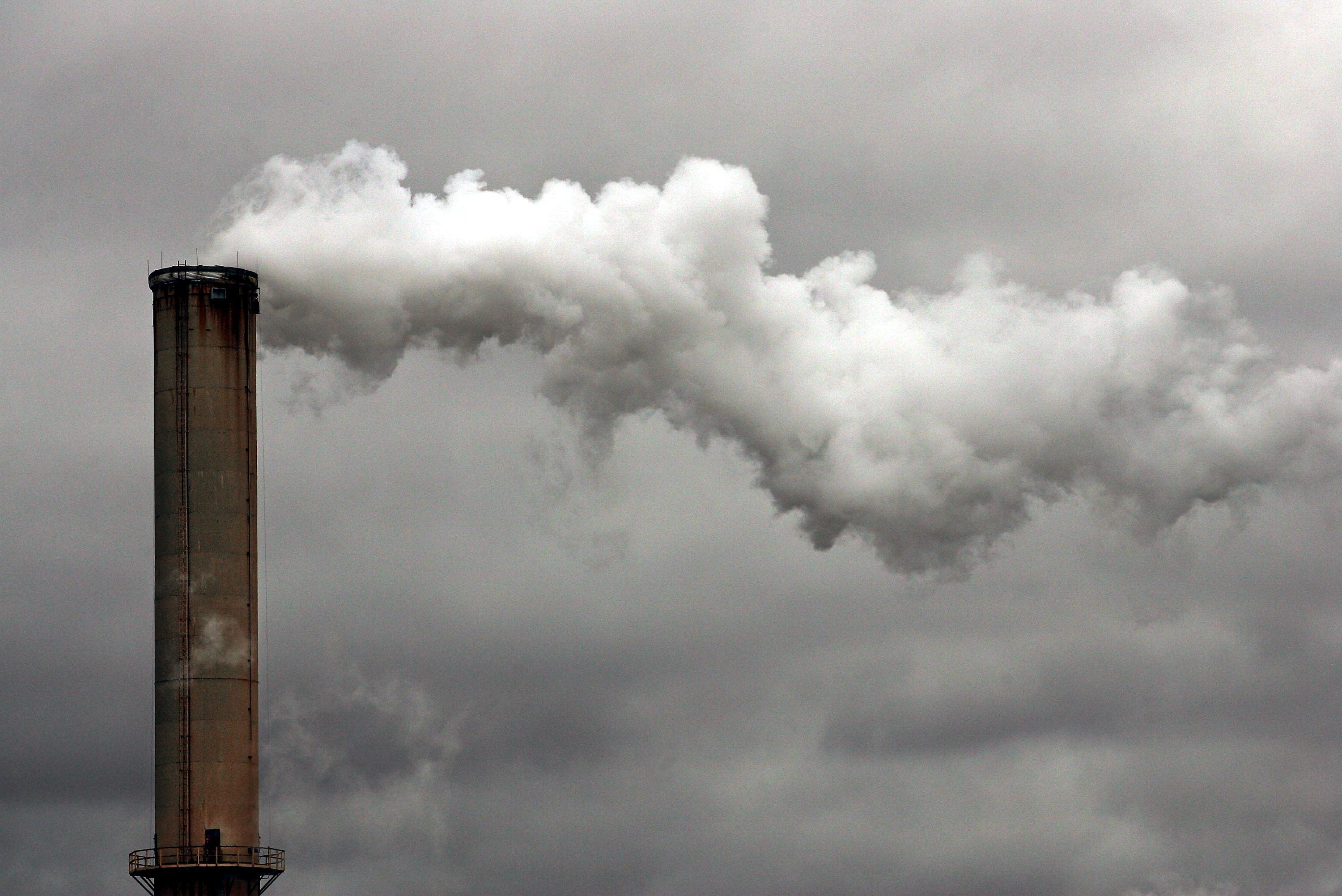 Steam rolls out of a factory's smoke stack  in Dayton, Ohio.