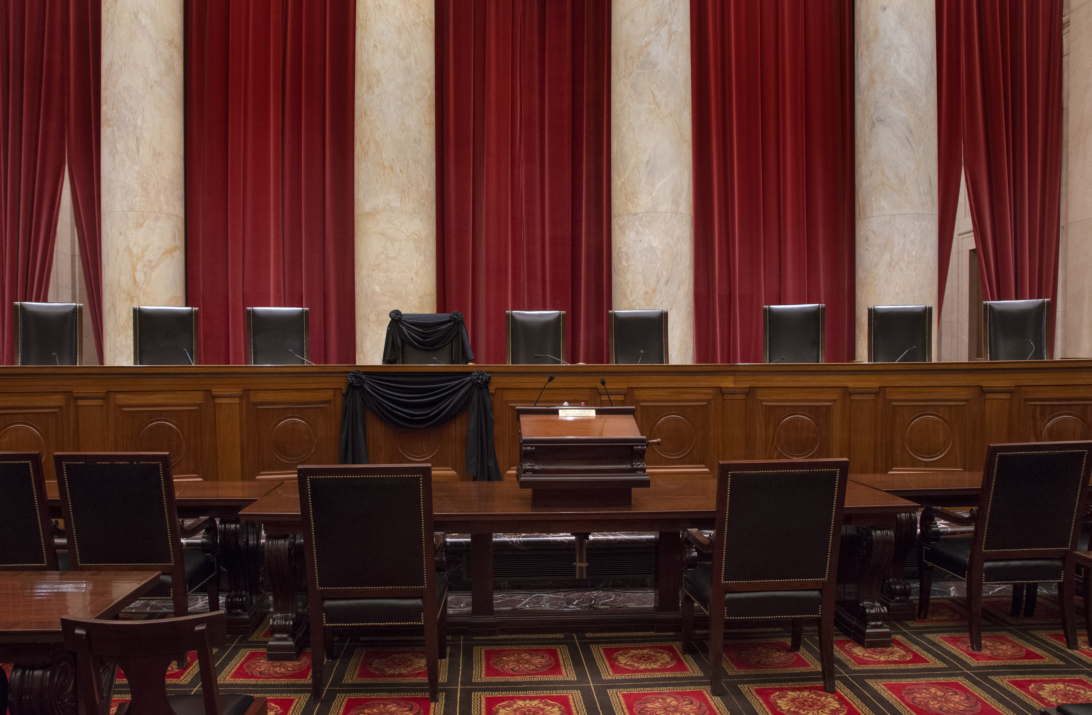 Associate Justice Antonin Scalia's bench chair and the bench in front of his seat are draped in black in the Courtroom of the Supreme Court following his Feb. 13, 2016 death.