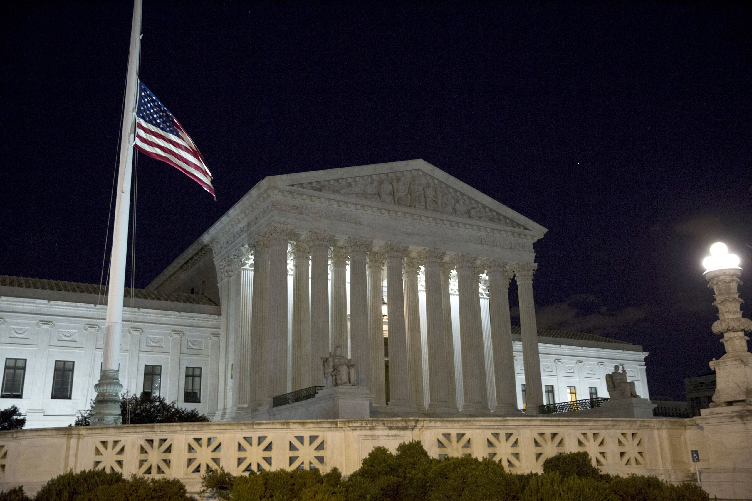 The American flag flies at half mast after the death of Supreme Court Justice Antonin Scalia at the U.S. Supreme Court in Washington on Feb.13, 2016.