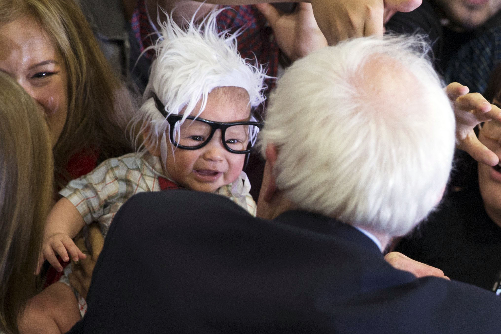 Democratic presidential candidate Sen. Bernie Sanders, I-Vt., meets 3-month-old Oliver Lomas, of Venice, Calif., during a rally at Bonanza High School, on Feb. 14, 2016, in Las Vegas.