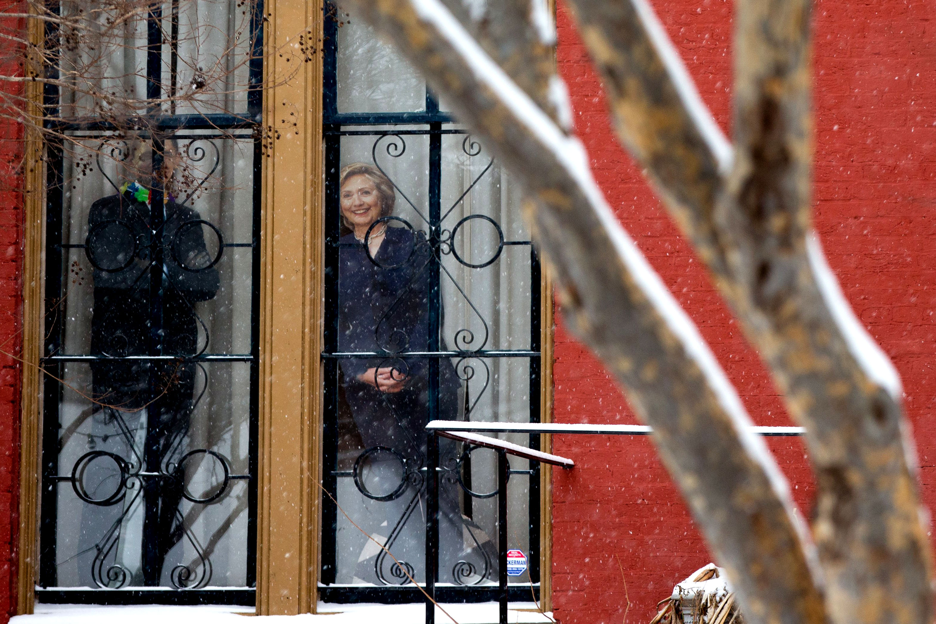 Cardboard cutouts of Democratic presidential candidate Hillary Clinton , right, and President Barack Obama are positioned in a window in the LeDroit Park neighborhood in Washington on Feb. 15, 2016.