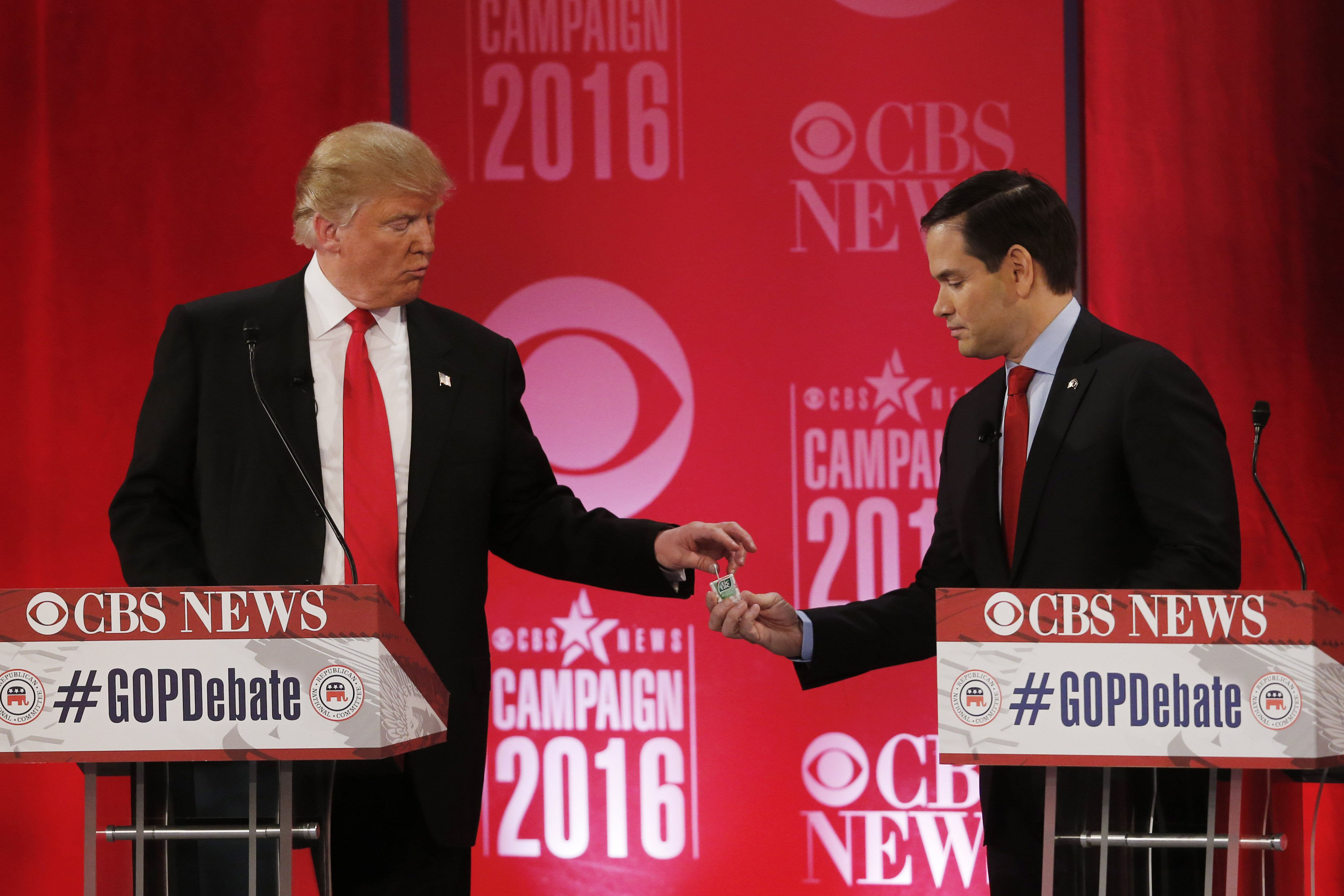 Republican presidential candidate, Sen. Marco Rubio, R-Fla., shares a  Tic-Tac mint with Republican presidential candidate, businessman Donald Trump during a Republican presidential debate at the Peace Center on Feb. 13, 2016, in Greenville, S.C.