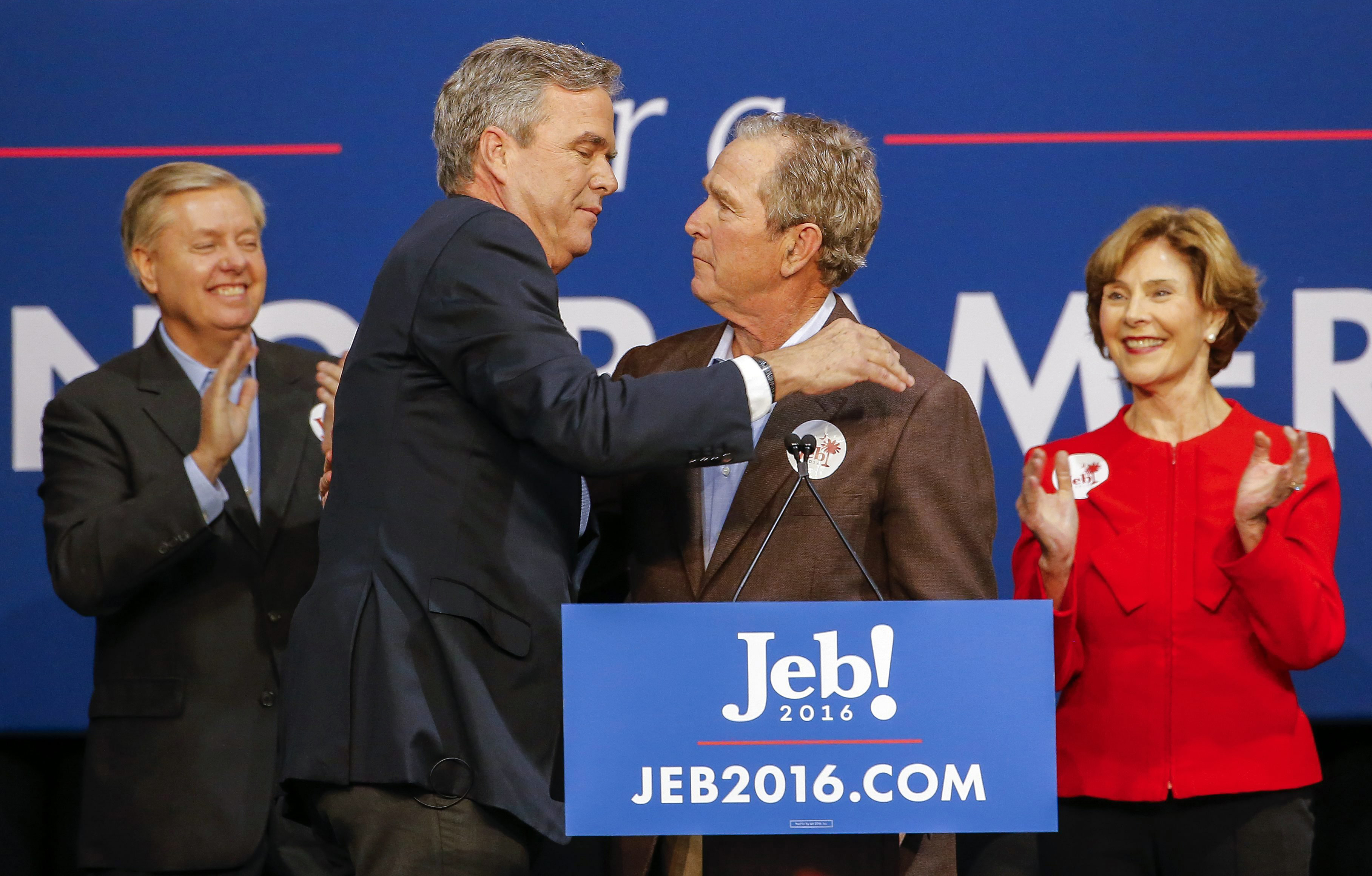 Republican presidential candidate and former Florida Gov. Jeb Bush, center left, participates in a campaign event with his brother, former U.S. President George W. Bush in North Charleston, S.C. on Feb. 15, 2016. Former First Lady Laura Bush, right, and South Carolina Senator Lindsey Graham, left, appear on stage.