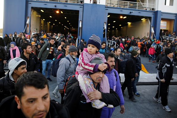 Syrian refugees are seen after they arrived to port of Piraeus by the passenger ships charted by Greek government in Athens, Greece on Jan. 31.