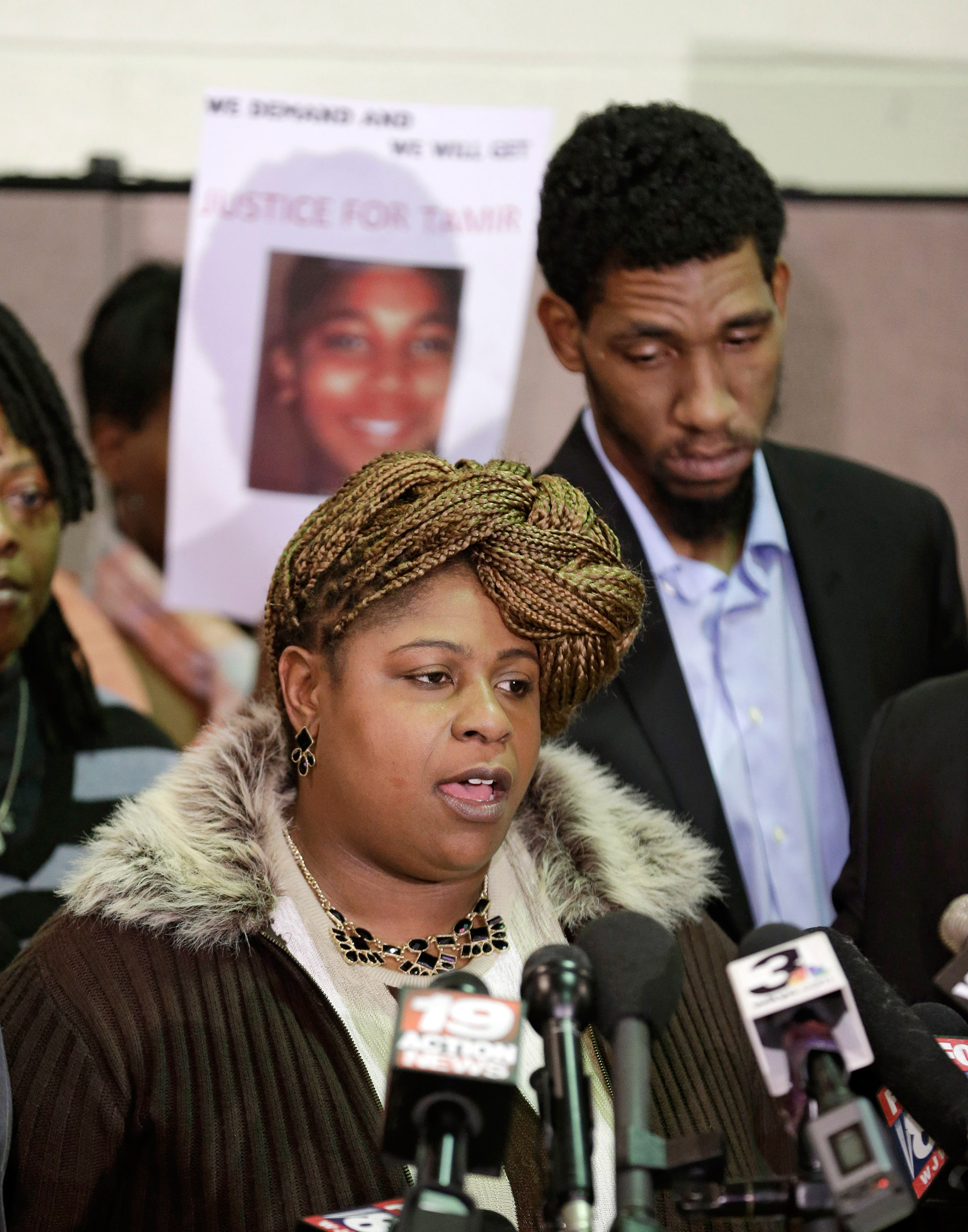 Samaria Rice, mother of Tamir, the 12-year-old boy who was fatally shot by a Cleveland police officer, speaks as Leonard Warner, Tamir's father, listens during a news conference in Cleveland, Ohio, Dec. 8, 2014.