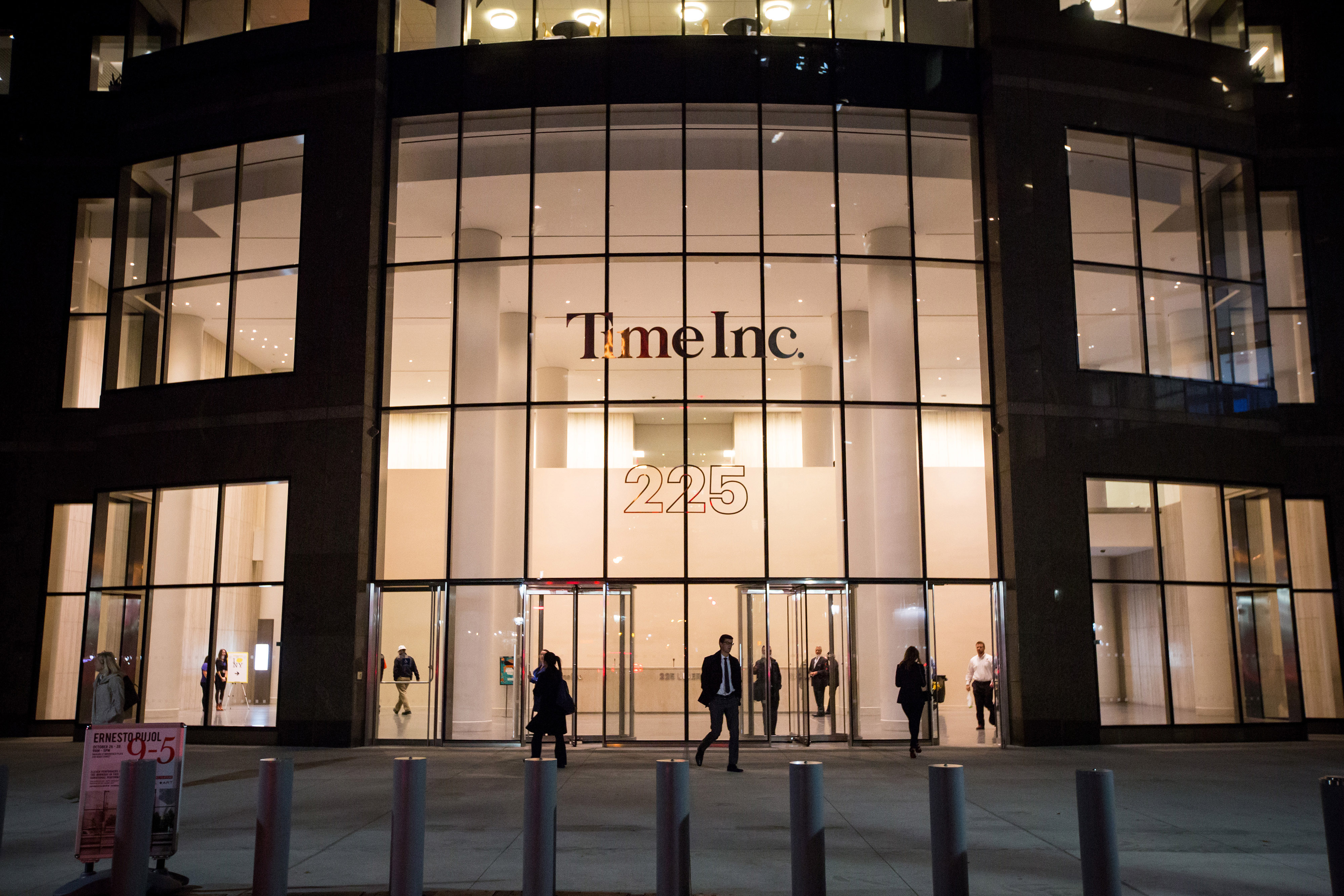 Pedestrians walk past the new headquarters of Time Inc. in New York, N.Y, on Tuesday, Oct. 27, 2015.