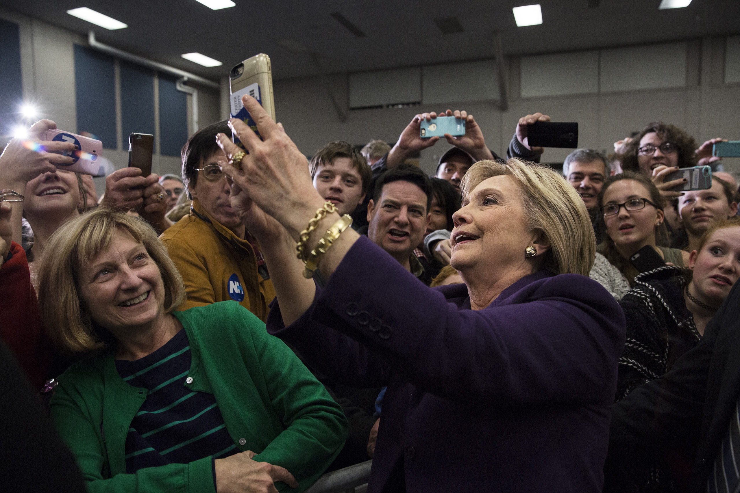 Democratic Presidential candidate Hillary Clinton takes selfies while campaigning at Winnacunnet High School in Hampton, N.H. Feb. 2, 2016.