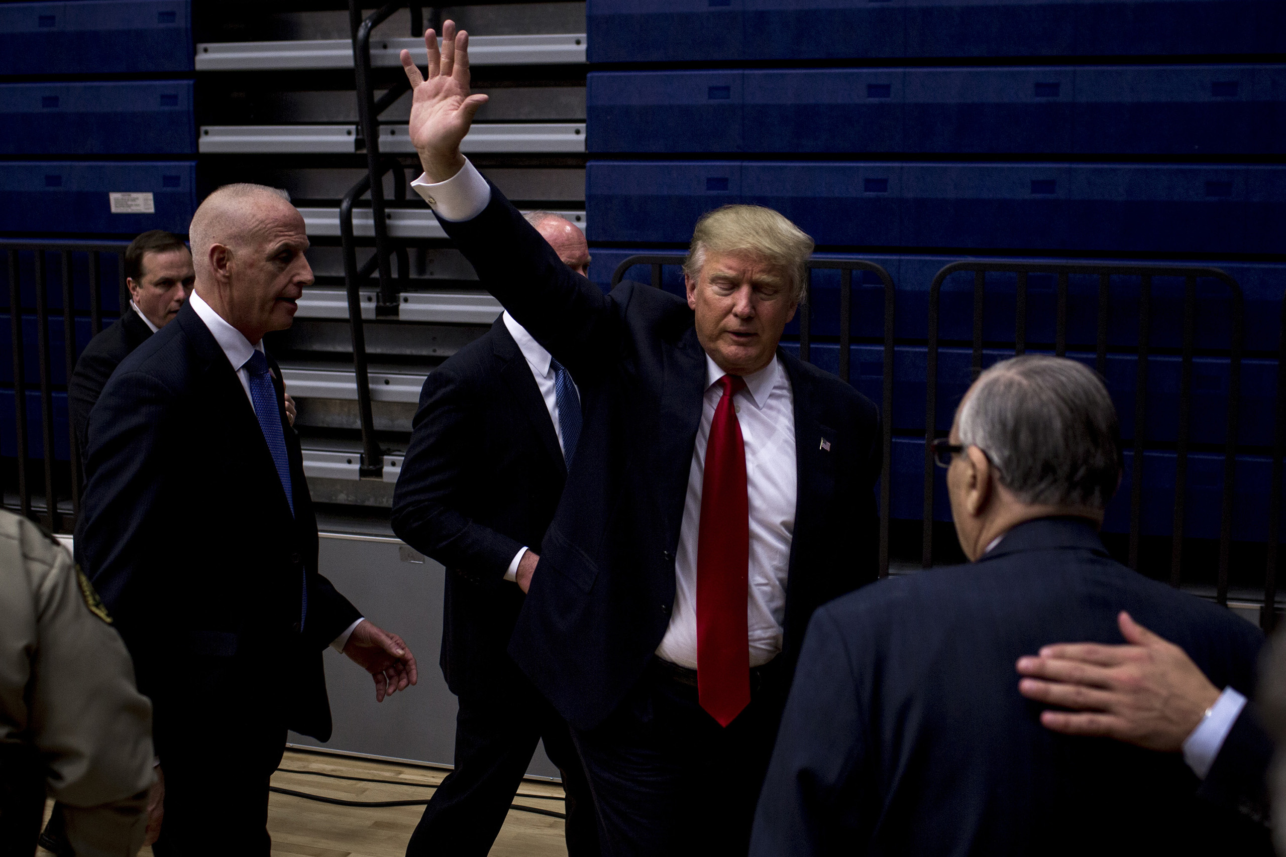 Donald Trump waves to supporters as he leaves  from a rally at Marshalltown Community School District - Roundhouse Gymnasium on Jan. 26, 2016.