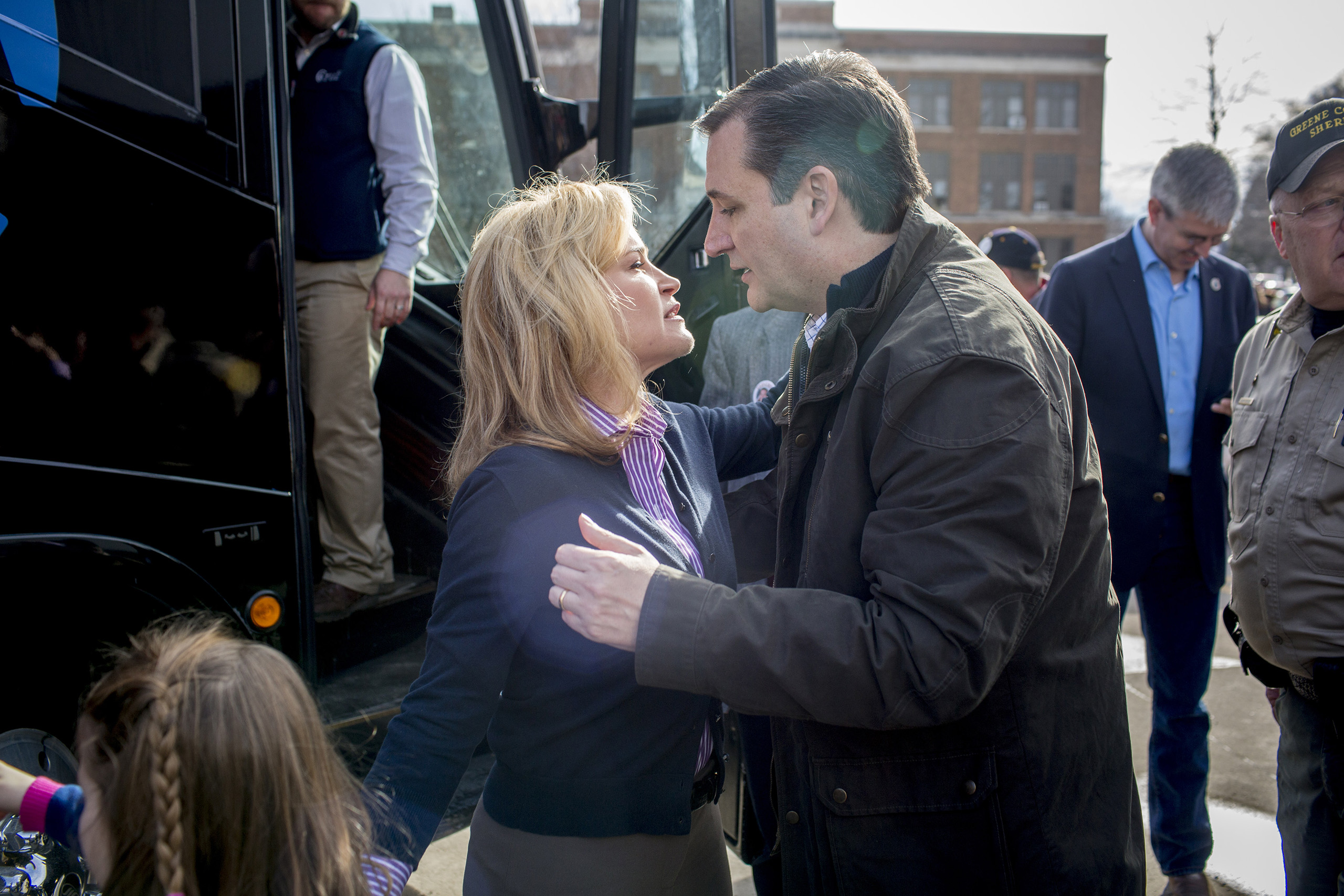 Ted Cruz embraces his wife before boarding the campaign bus at a stop at Greene County Community Center in Jefferson, Iowa, on Feb. 1, 2016.