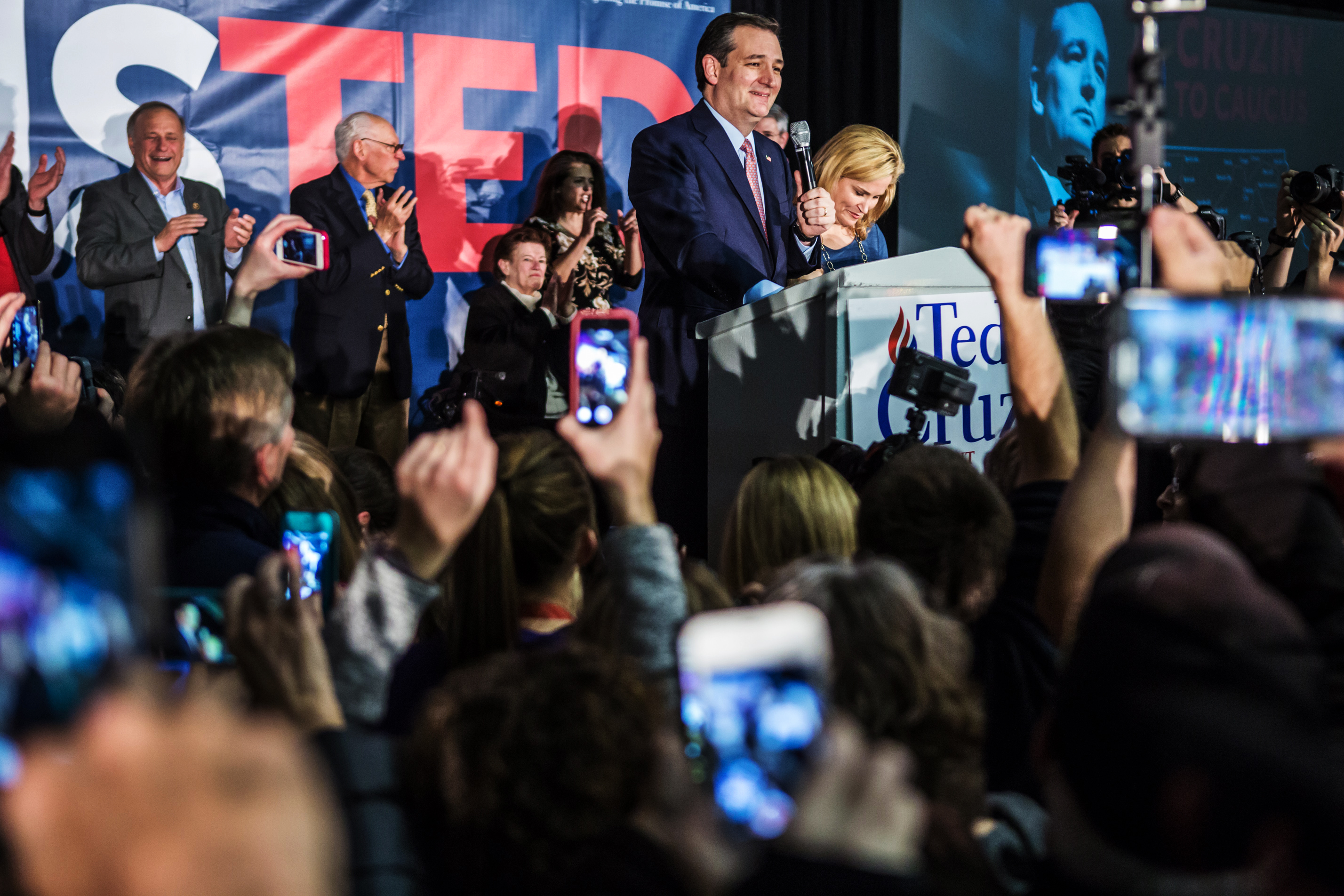 Republican presidential candidate Sen. Ted Cruz, r-TX, joined by his wife Heidi Cruz, speaks at a caucus night rally in Des Moines, Iowa, on Feb. 1, 2016.