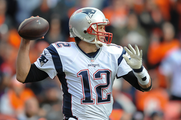 Tom Brady #12 of the New England Patriots passes against the Denver Broncos in the AFC Championship game at Sports Authority Field at Mile High on January 24, 2016 in Denver, Colorado.