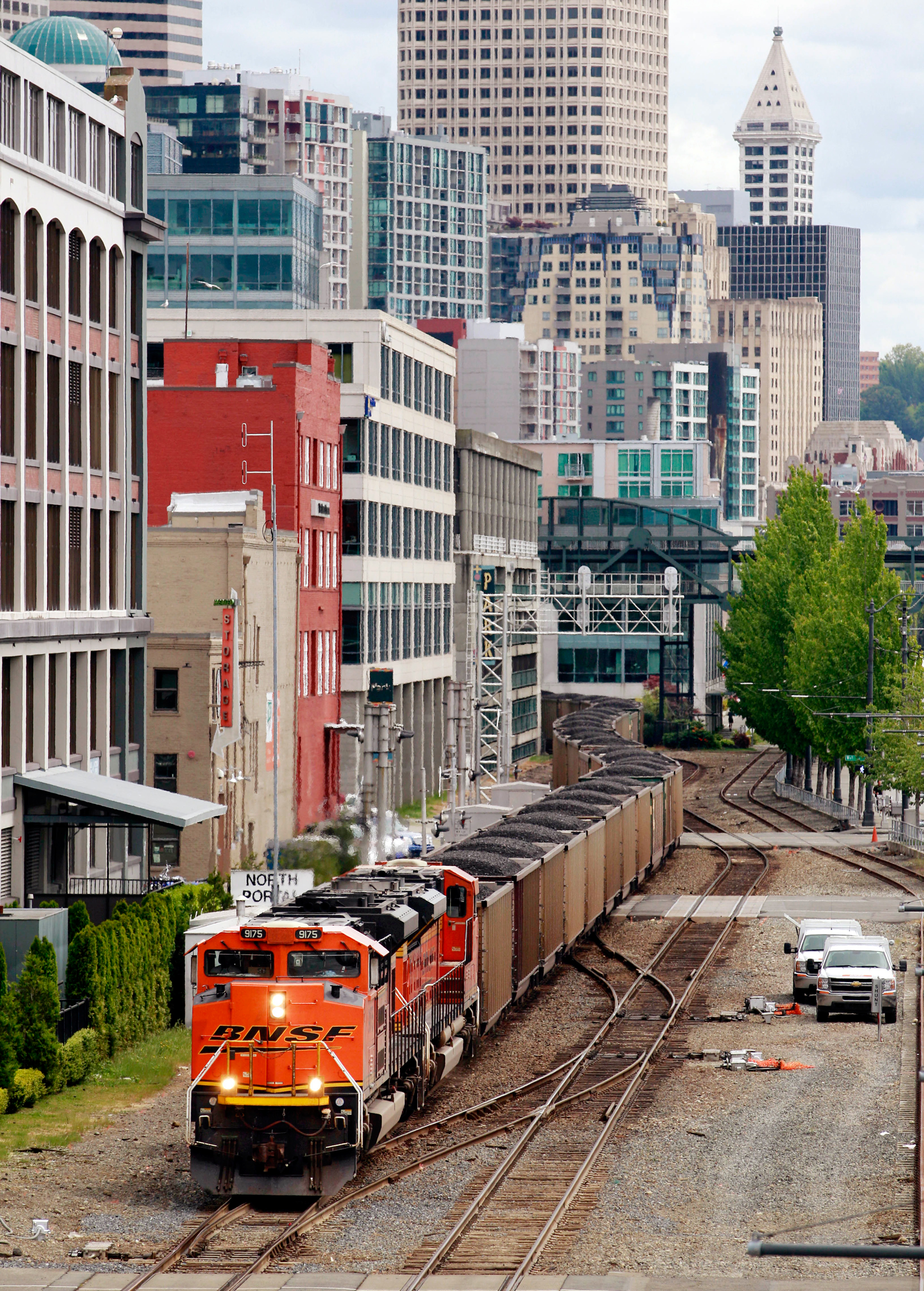 A train hauls coal bound for Canada through downtown Seattle