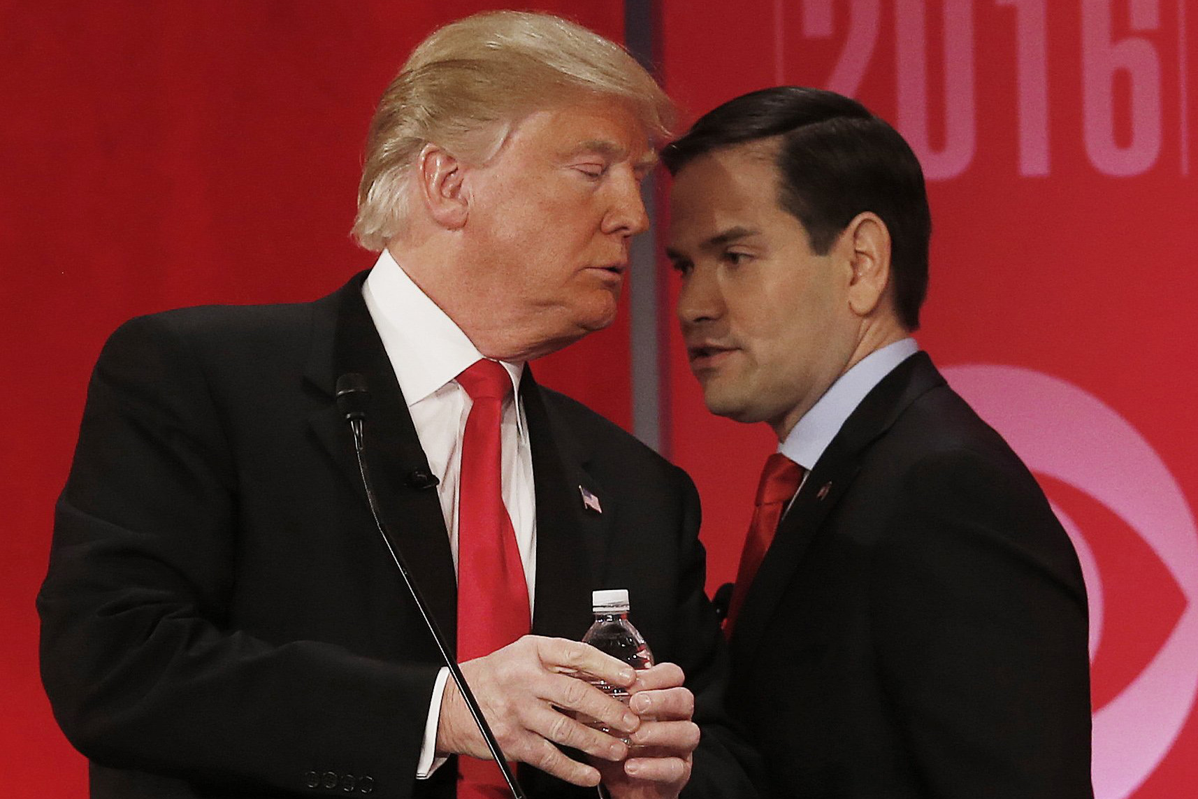 Republican presidential candidate, Sen. Marco Rubio, right, speaks to Republican presidential candidate Donald Trump during the CBS News Republican presidential debate at the Peace Center in Greenville, S.C., Feb. 13, 2016.