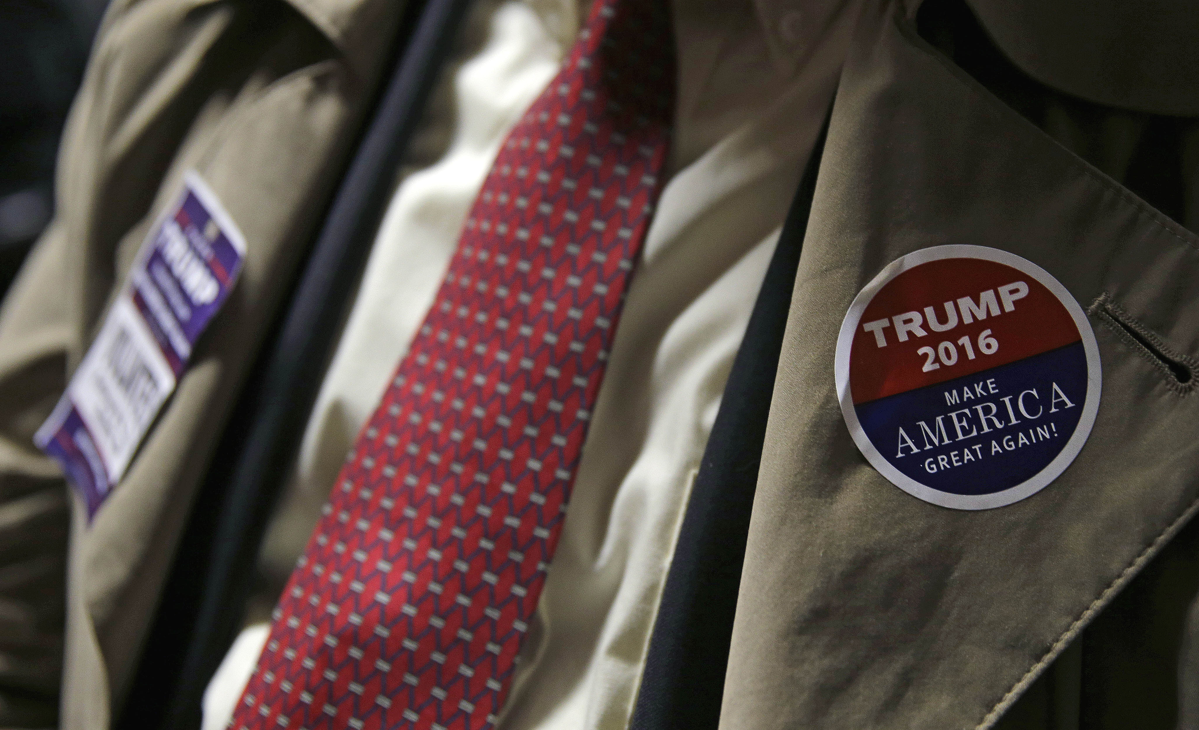 A supporter of Republican presidential candidate Donald Trump sits in the audience during a campaign stop at an Elks Lodge in Salem, N.H., Feb. 8, 2016.