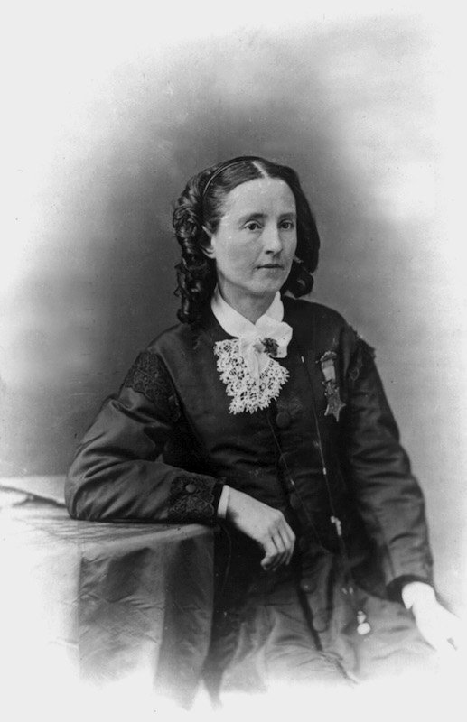Dr. Mary Edwards Walker, seated, wearing Medal of Honor. Undated.