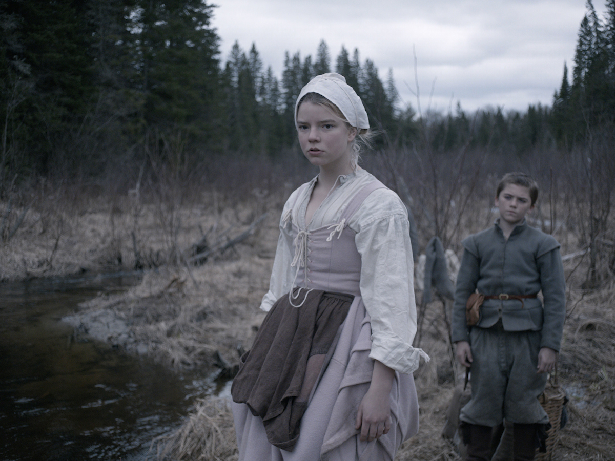 This photo provided by courtesy of A24 shows Anya Taylor-Joy, left, as Thomasin, and Harvey Scrimshaw as Caleb in a scene from the film,  The Witch.