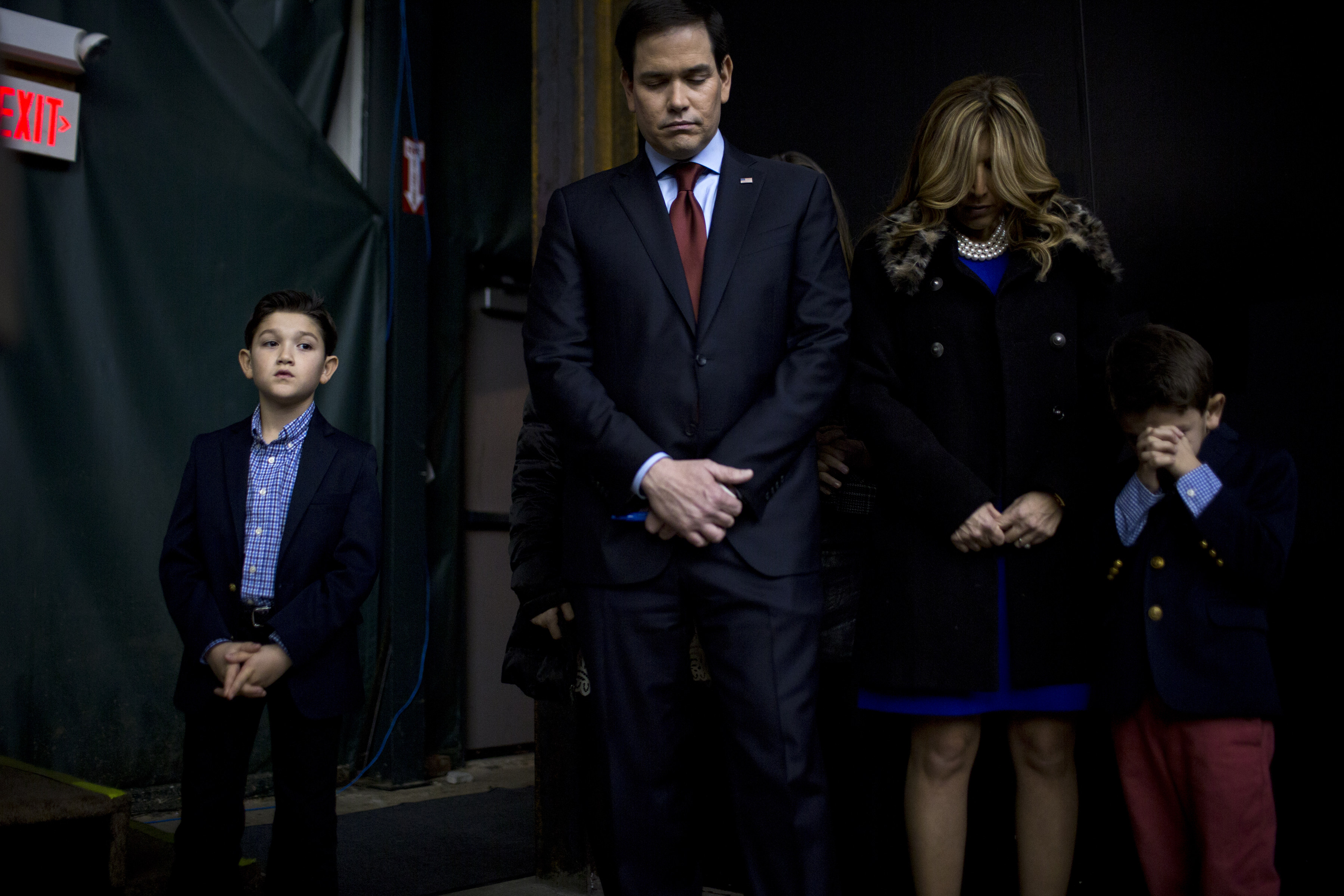 Marco Rubio appears with his family at his caucus location in Clive, Iowa, on Feb. 1, 2016.