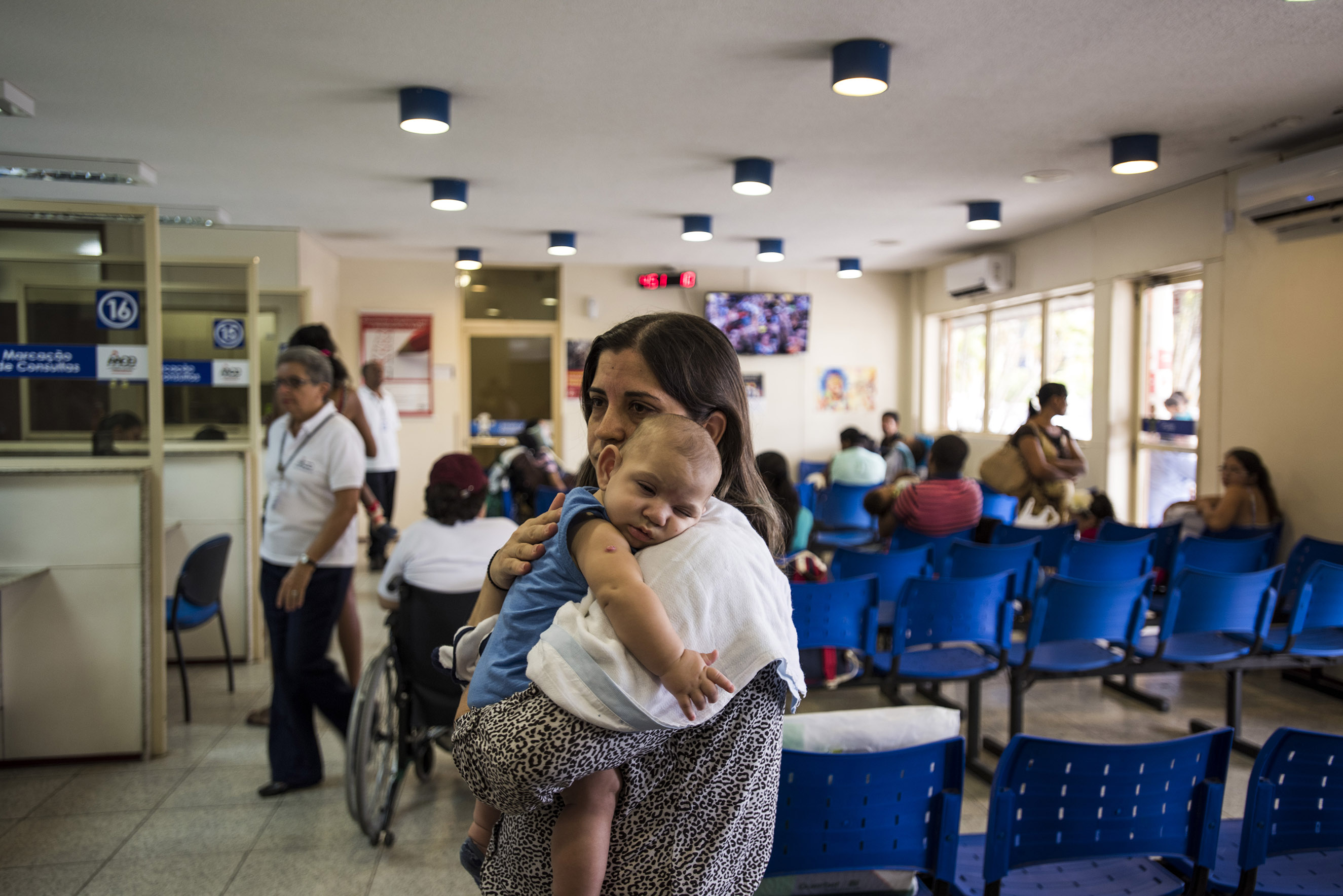 Isabel Albuquerque and her son in the waiting room of Associacao de Assistencia a Crianca Deficiente, a rehabilitation center for disabled children, in Recife, Brazil, Feb. 1, 2016.