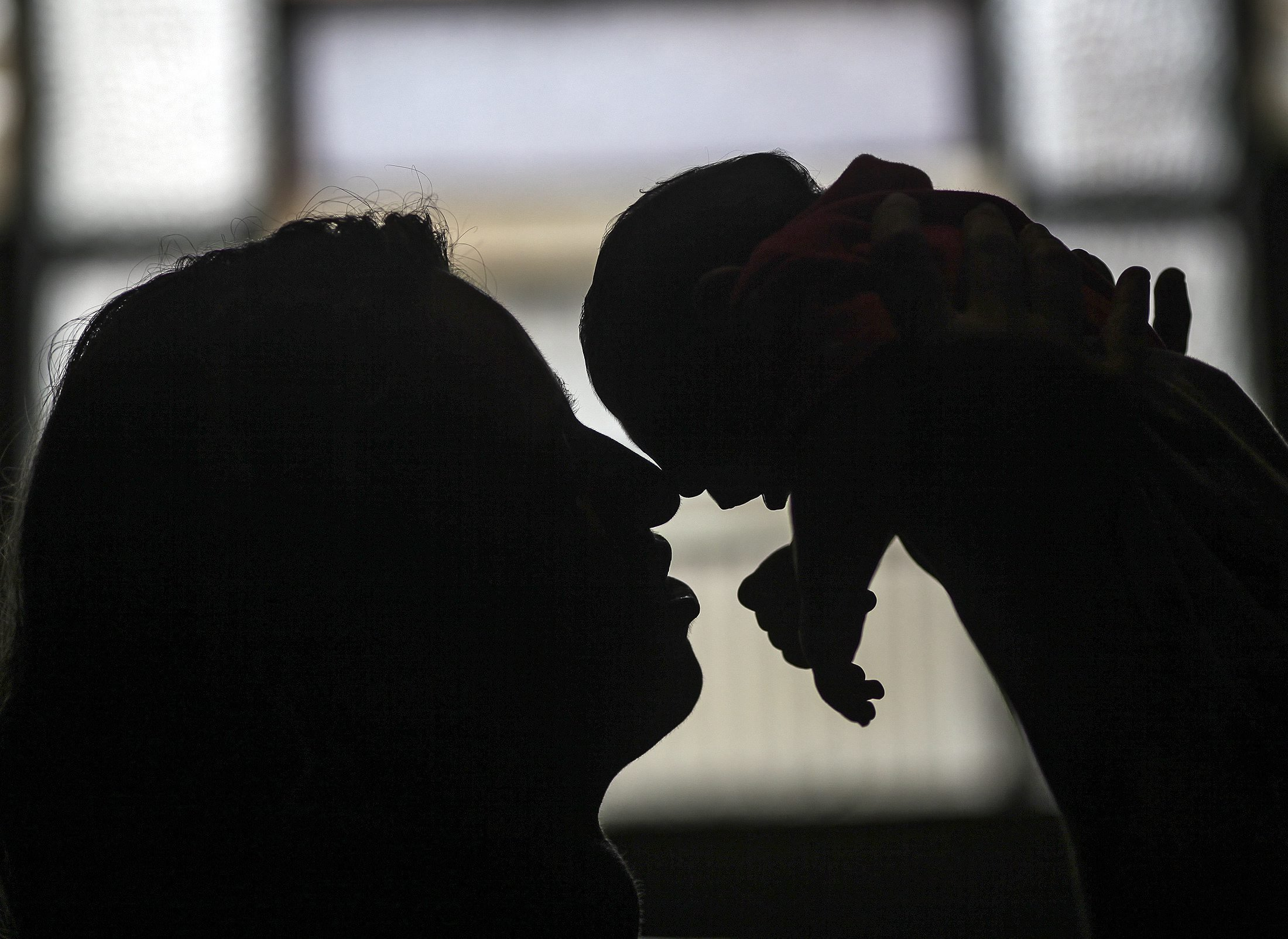 Patricia Vieira de Araujo holding her granddaughter, who was born with microcephaly in Rio de Janeiro, on Feb. 11, 2015.