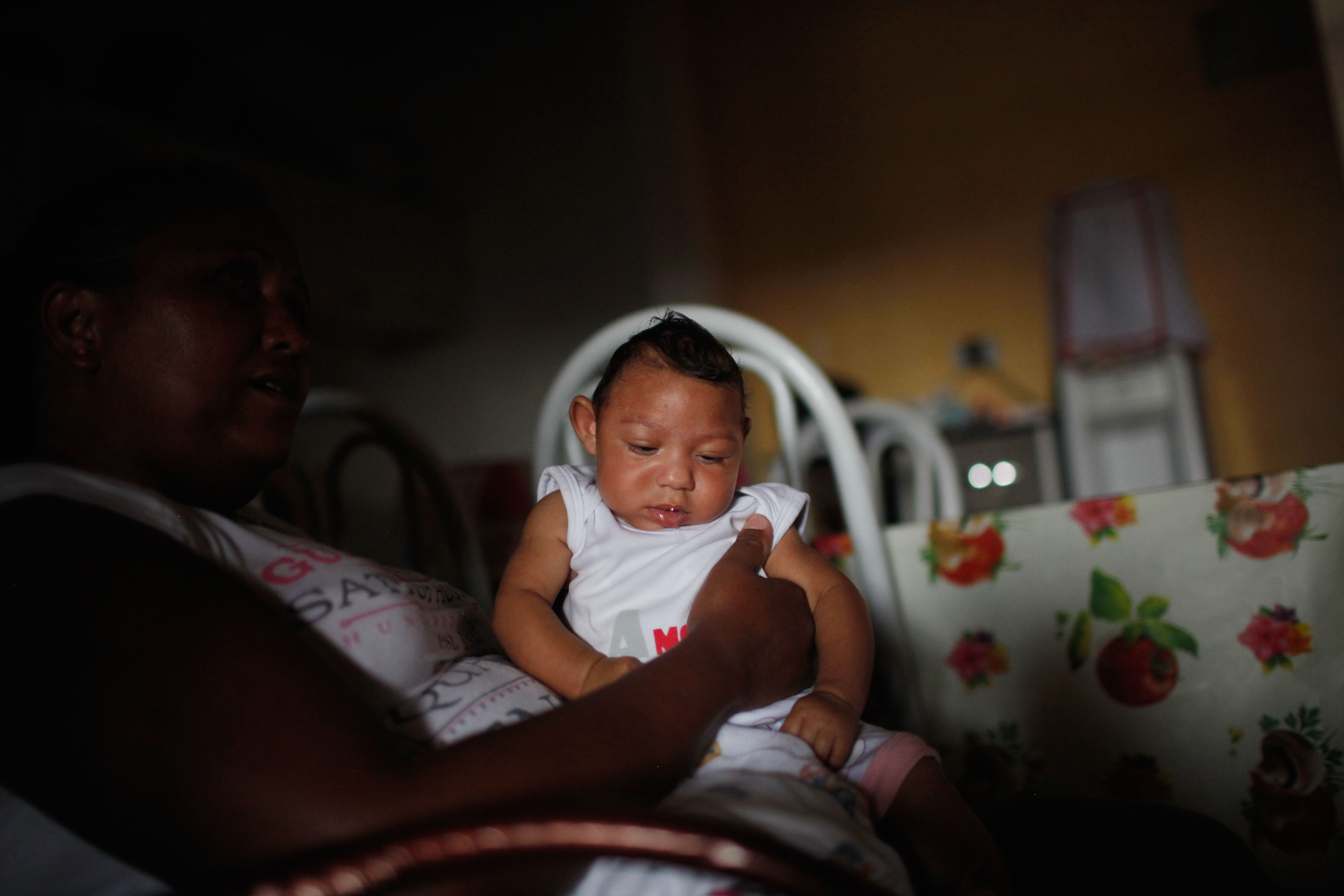 Alice Vitoria Gomes Bezerra, 3 months old, who has microcephaly, is held by her mother Nadja Cristina Gomes Bezerra in Recife, Brazil, on Jan. 31, 2016.