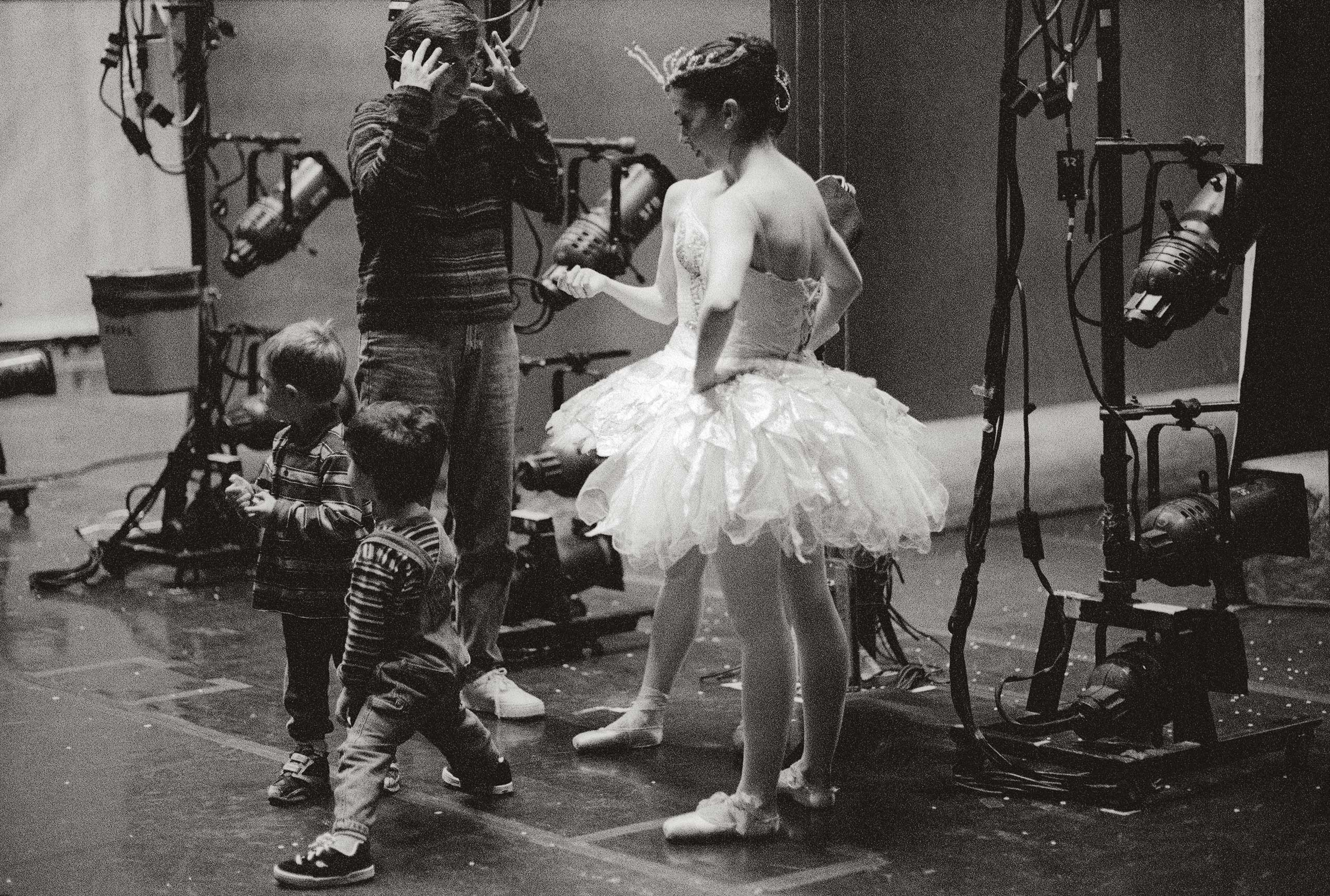After a dress rehearsal of Nutcracker (Marius Petipa), Kristin shows the stage to Kai and Michael. 2000. Balancing Acts: Three Prima Ballerinas Becoming Mothers.