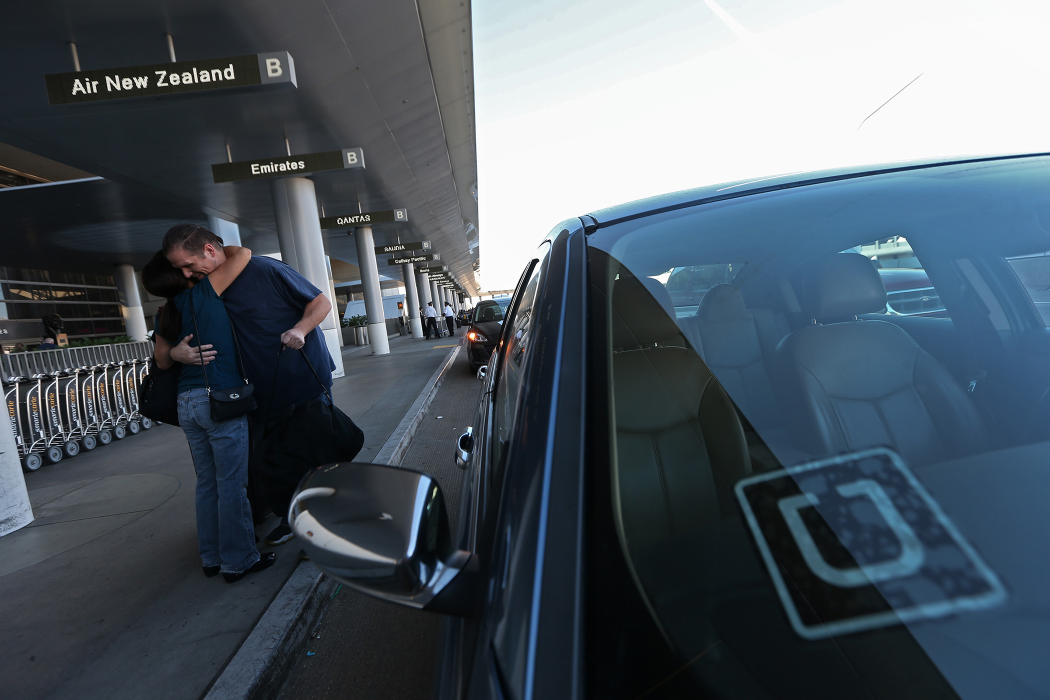 An Uber driver drops off a passenger at LAX, October 20, 2015.