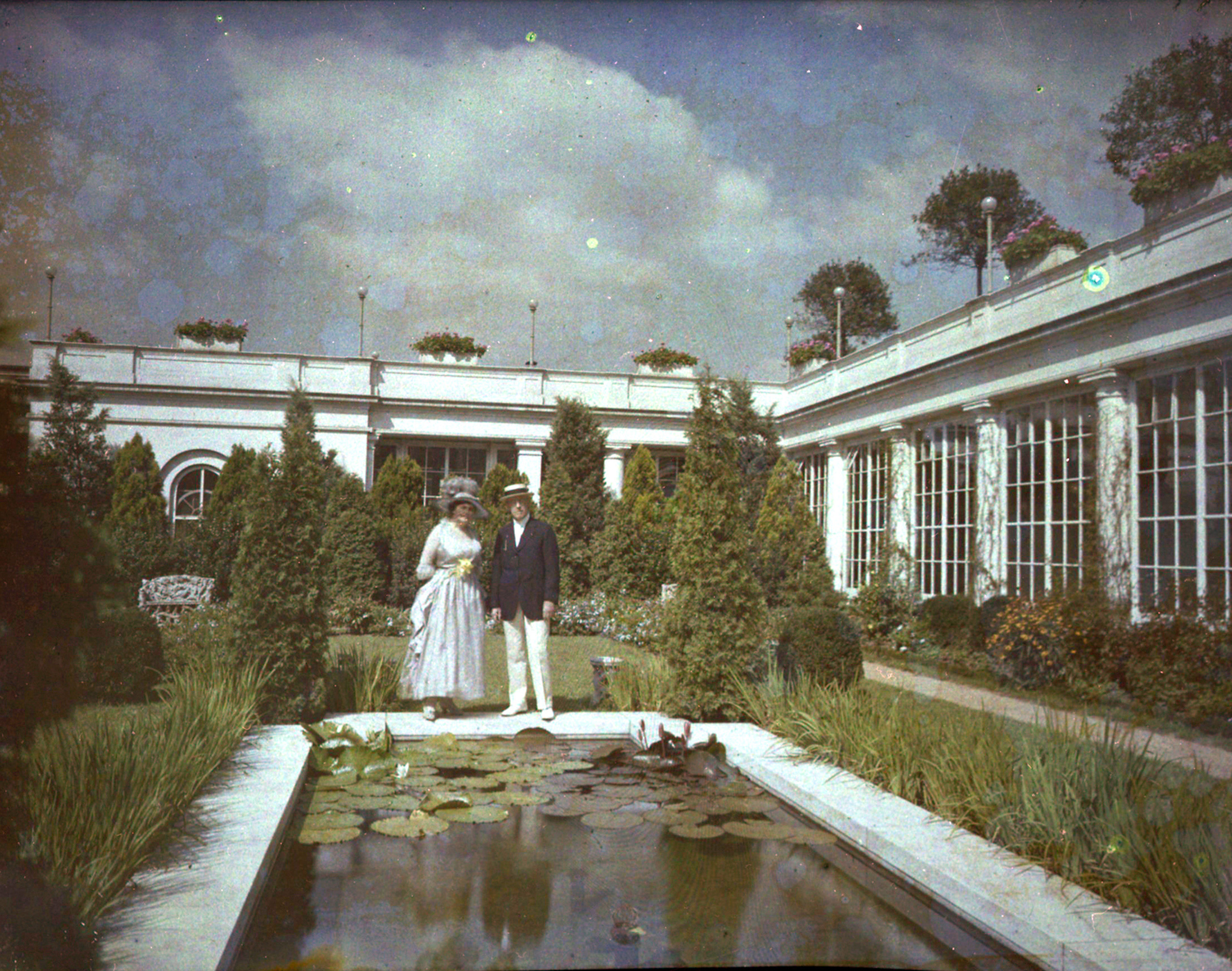 Edith and Woodrow Wilson enjoy the East Garden in their summer finery.