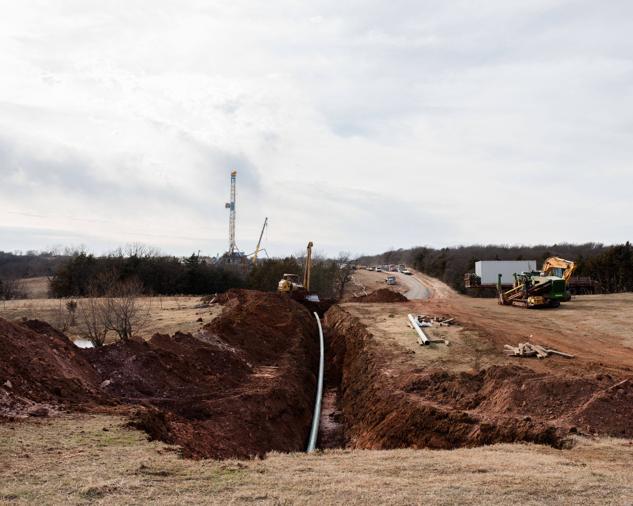 Construction crews work on the installation of an underground oil pipeline, Coyle, OK
