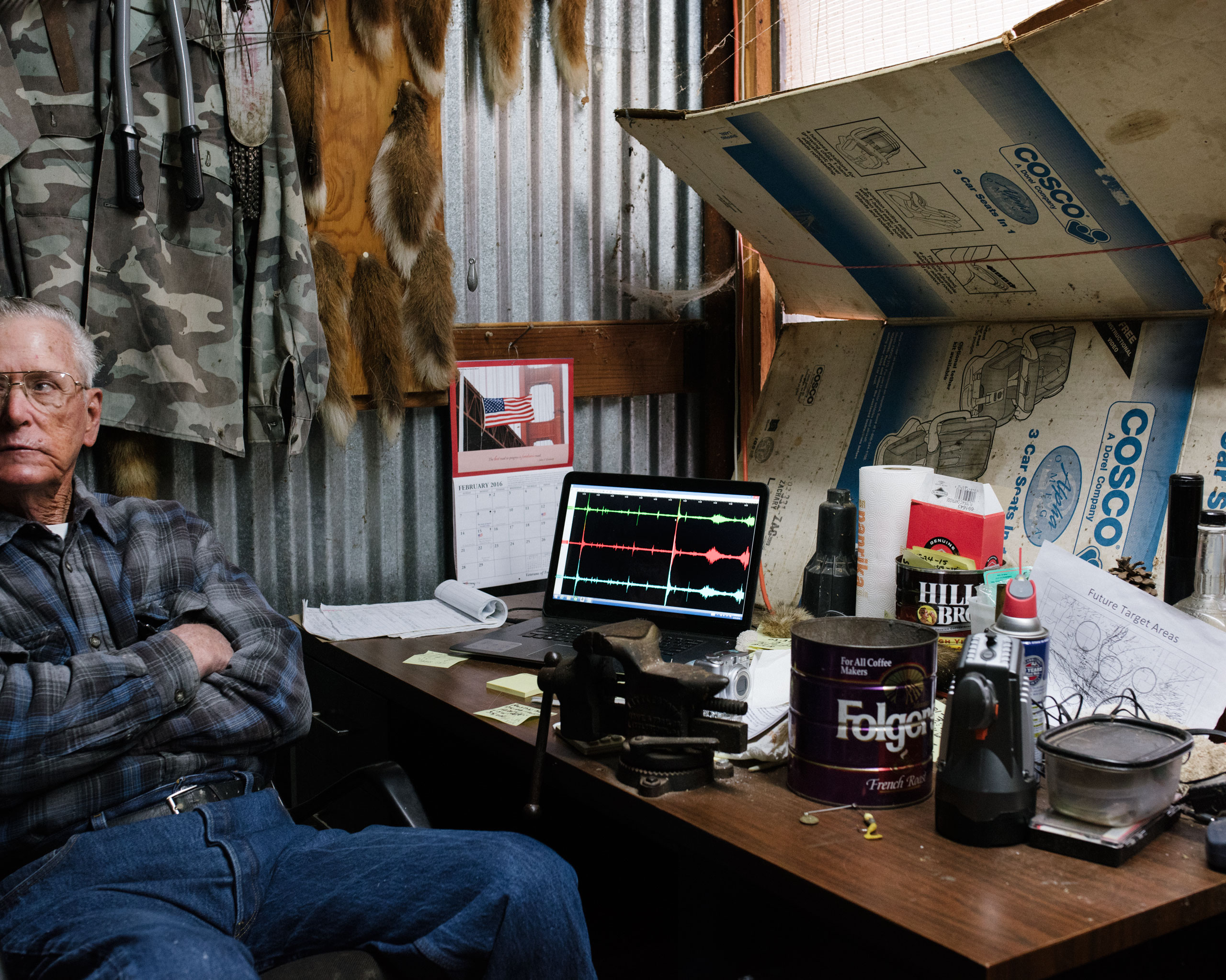 Marc Crismon, an amateur seismologist, has a personal seismometer on his property hooked up to a laptop where he monitors seismic activity, Glenco, OK