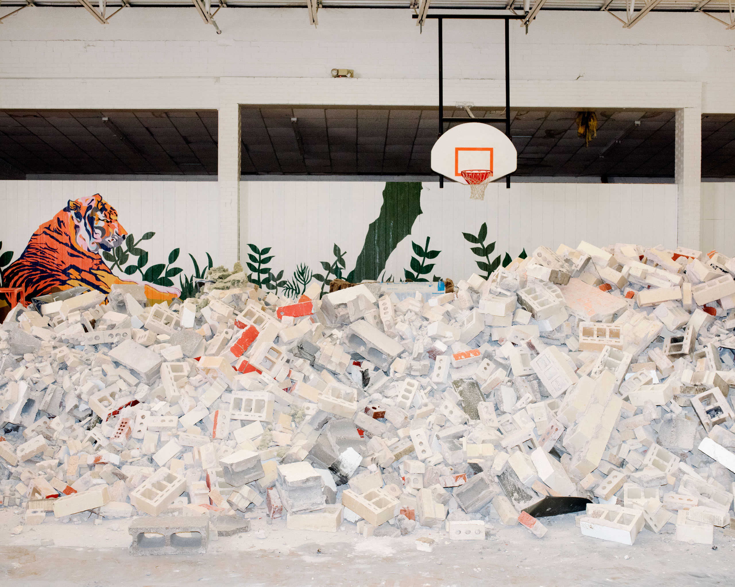 Cinder blocks left from demolition are piled in Crescent High School's gymnasium. An earthquake on July 28, 2015 destabilized the gymnasium's walls forcing the school to repair the entire structure, Crescent, OK
