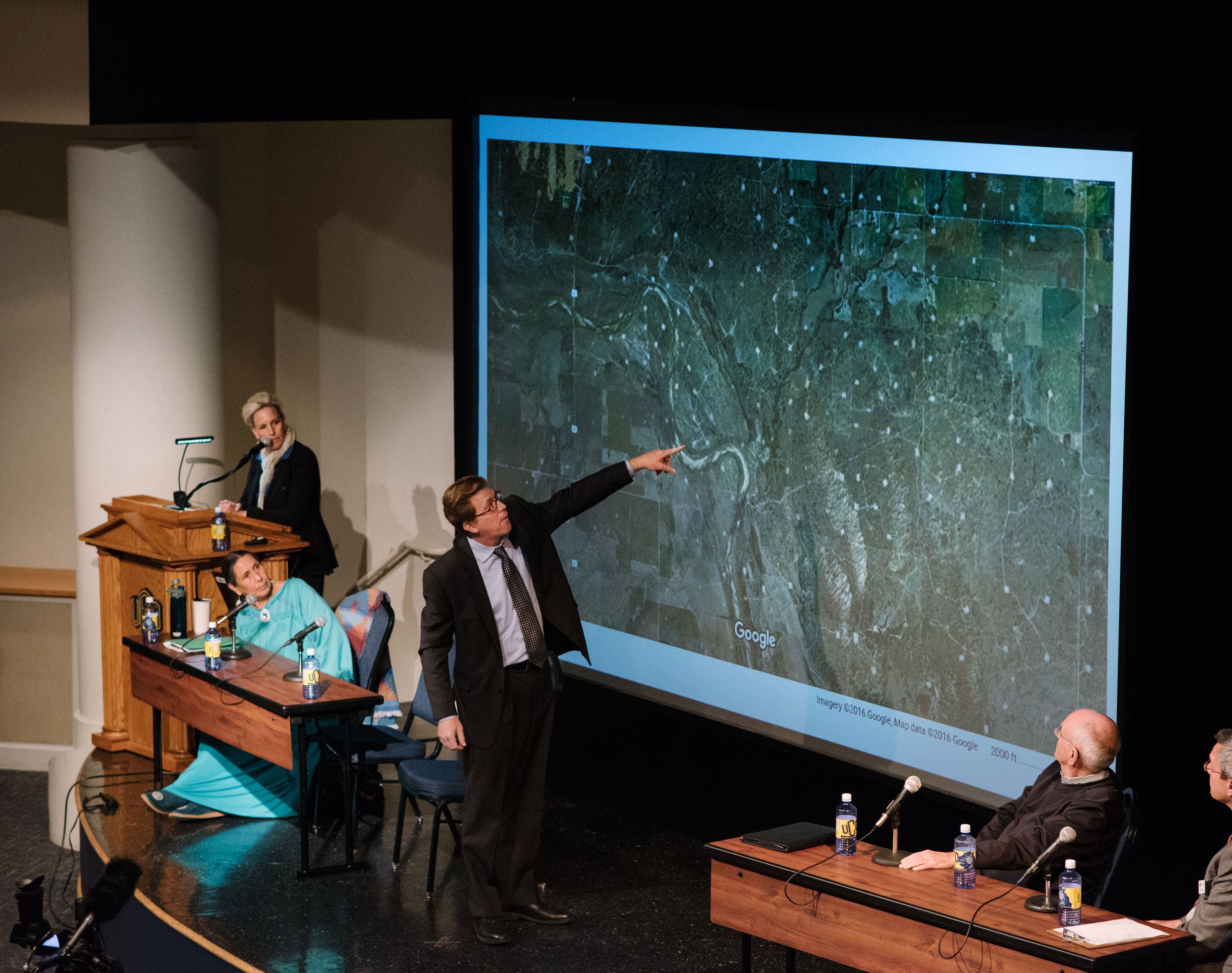 Johnson Bridgewater from the Sierra Club, points to areas affected by earthquakes at a public forum event hosted by Erin Brockovich and attended by notable public figures such as Casey Camp-Horinek from the Ponca Nation. Edmond, OK