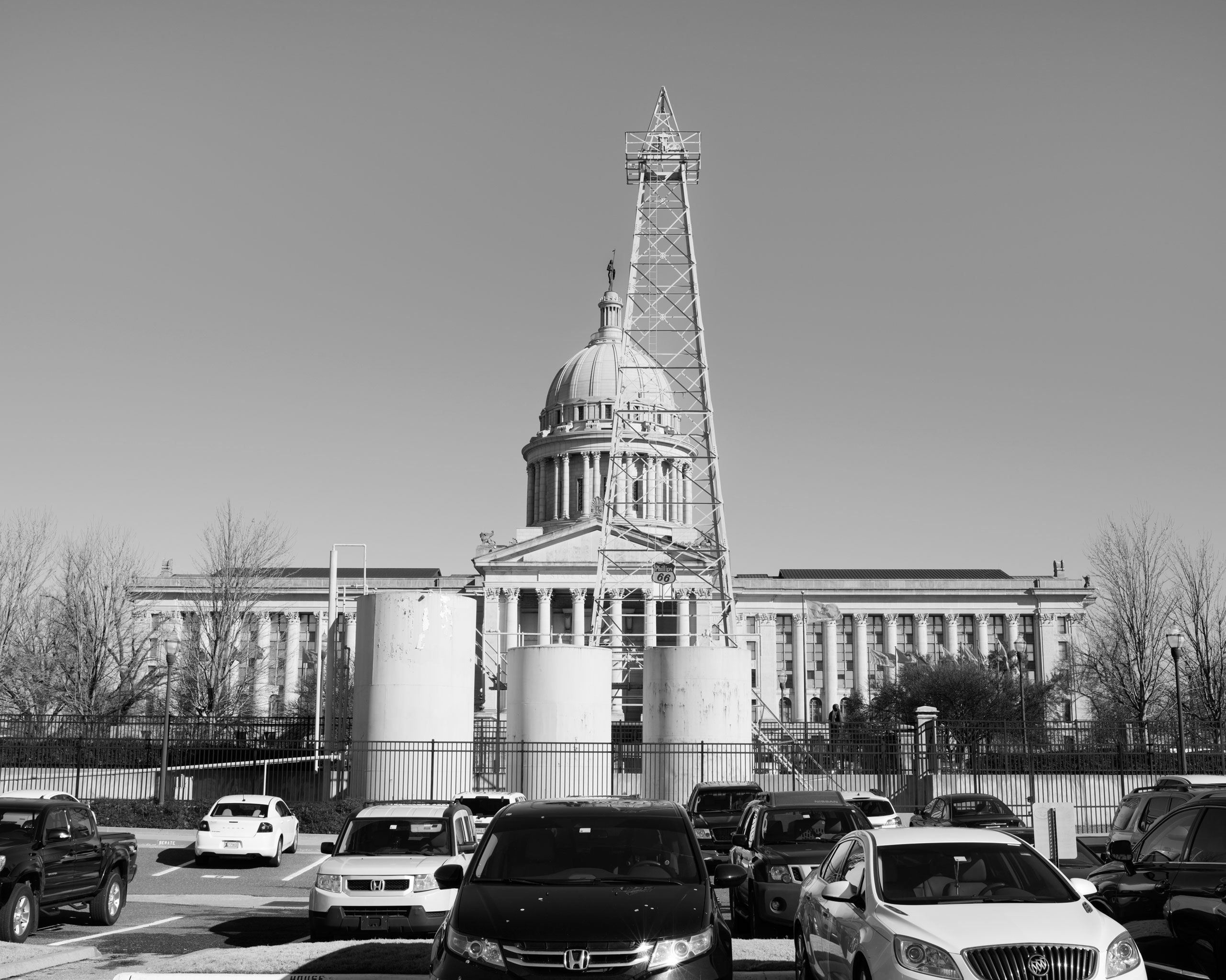 An oil rig stands in front of the Oklahoma State Capitol building, Oklahoma City, OK