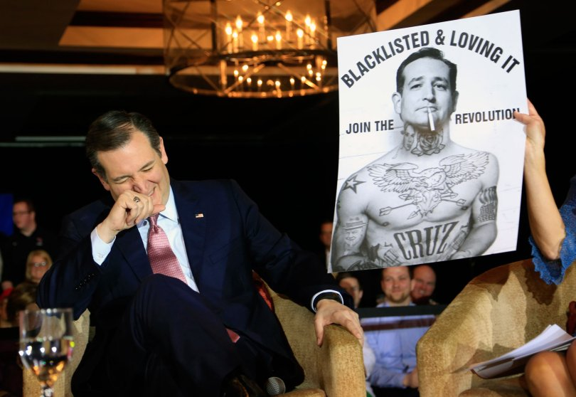 Republican presidential candidate, Texas Sen. Ted Cruz laughs at a poster in his likeness at a town hall event on March 30, 2016 in Madison, Wis.