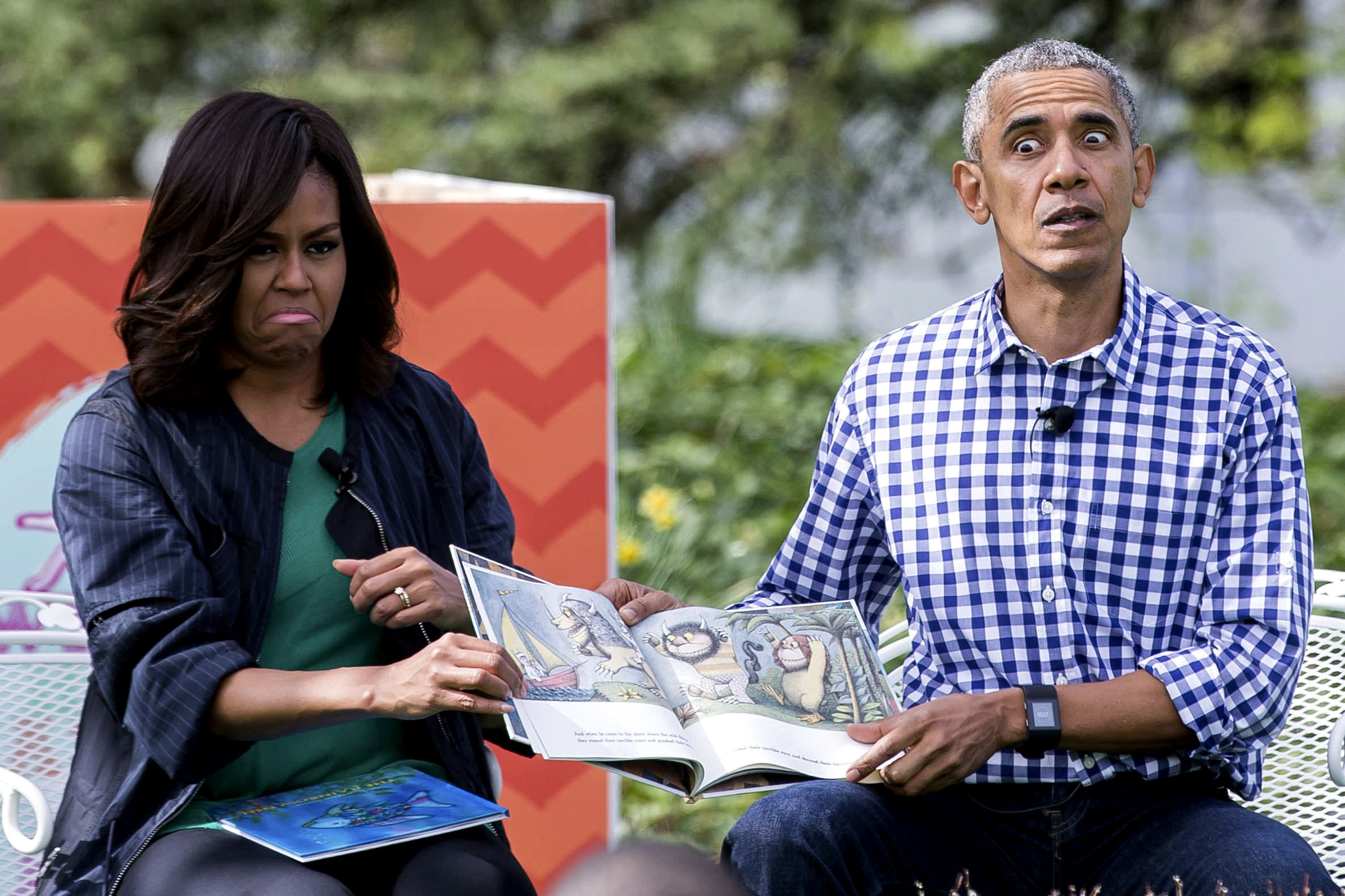 U.S. President Barack Obama and First Lady Michelle Obama read the book  Where the Wild Things Are  to a group of children during the 138th annual White House Easter Egg Roll in Washington on March 28, 2016.