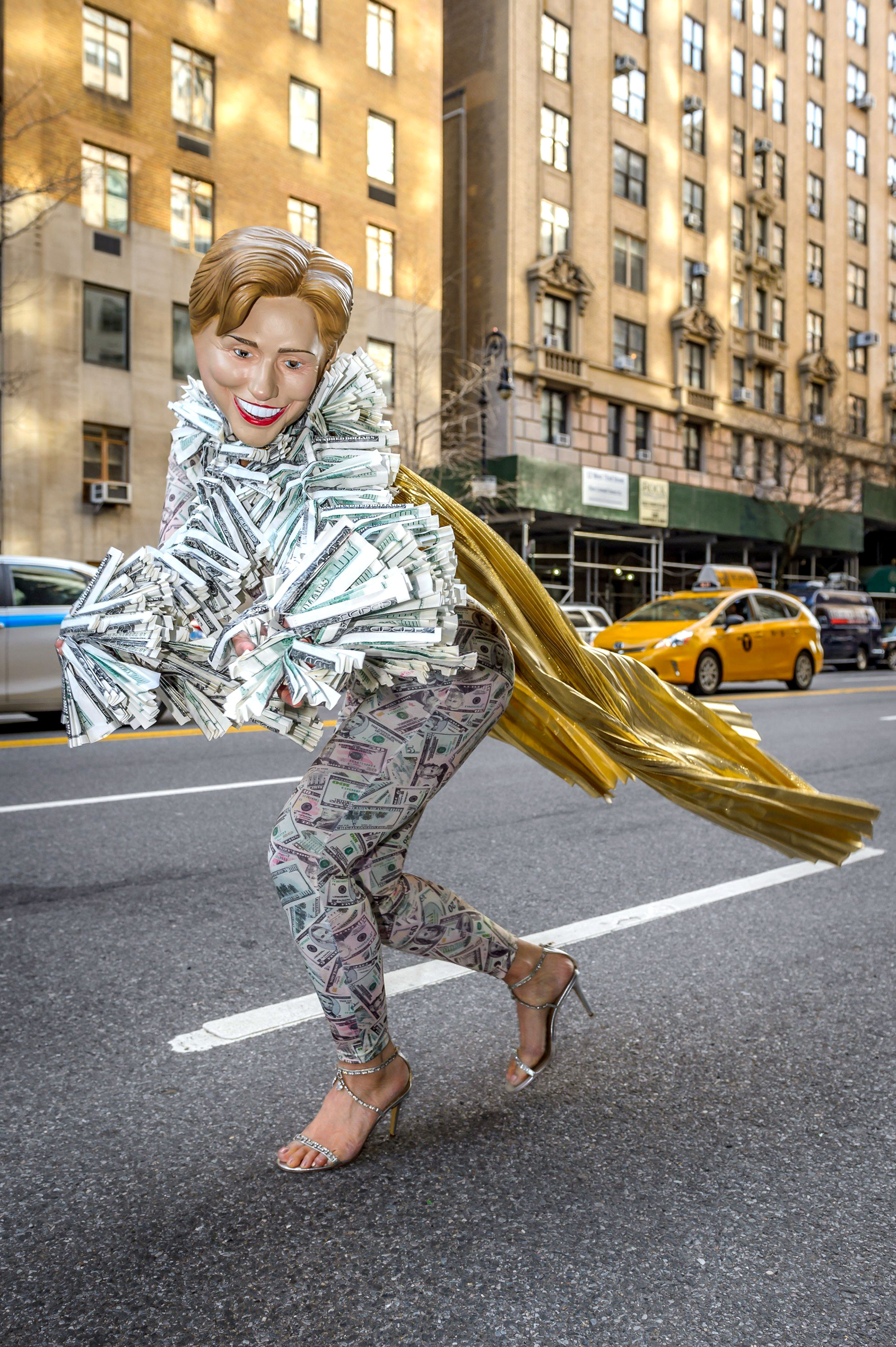 An activist dresses in the likeness of Hillary Clinton to protest the price of a fundraising dinner on March 30, 2016 in New York.