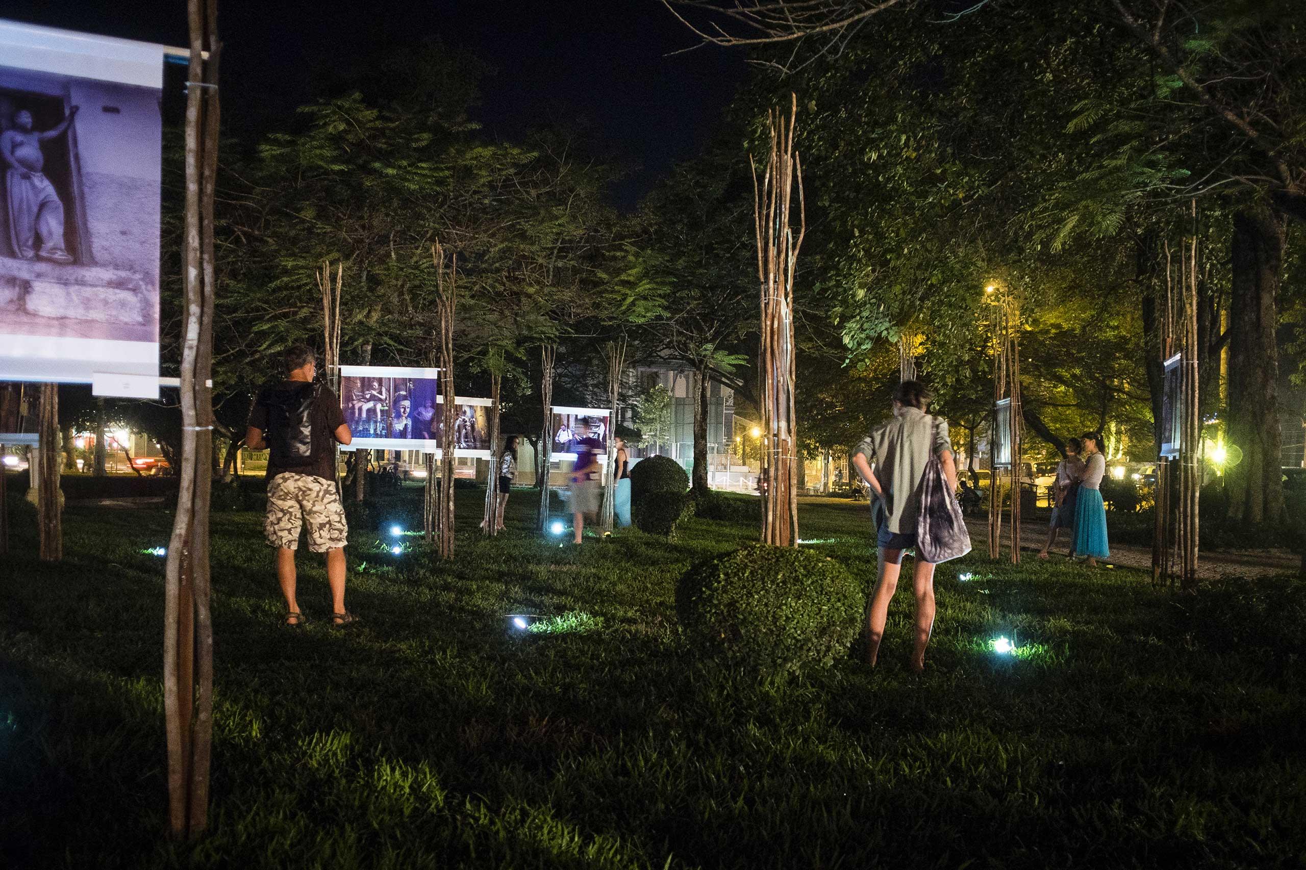 Visitors view the Gabi Ben-Avraham exhibition at Angkor Photo Festival in Dec. 2015.