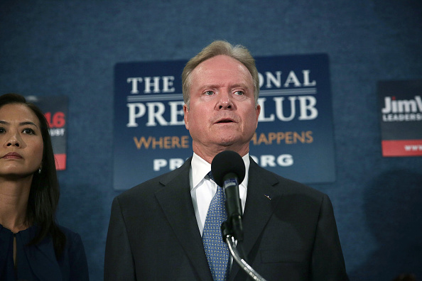 Former U.S. Sen. Jim Webb (D-VA) speaks as his wife Hong Le Webb listens during a news conference at the National Press Club October 20, 2015 in Washington, DC. Alex Wong—Getty Images