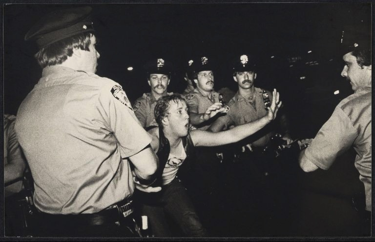 "Bettye Lane (1930–2012)A documentary photographer who captured and preserved images of feminist activism and other social rights issues. In this photograph, gays arrested at anti-""Cruising"" film demonstration. A photograph from the 1969 Stonewall protests by Ms. Lane that appeared in a 2010 documentary, ""Stonewall Uprising."""