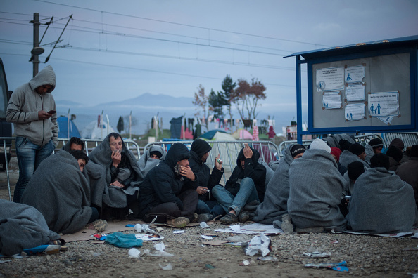 Migrants at sunrise in the camp of Idomeni at the border between Greece and Macedonia on March 6, 2016