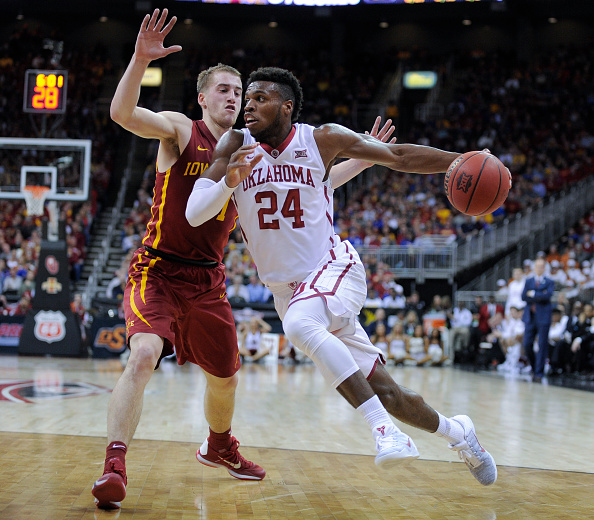 Buddy Hield (#24) of Oklahoma drives to the basket against Iowa State during the quarterfinals of the Big 12 Basketball Tournament in Kansas City, Missouri on March 10, 2016.